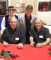 Back left: Larry Pytel and Paul Kaczorowski, with Front left: Sal Martocci and Tony Minichello, accordionists, at the Christmas Eve dinner last year for Polish Heritage  of Tallahassee.
