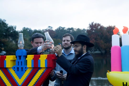 Rabbi Schnuer Zalman Oirechman lights the Lego menorah to mark the beginning of Hanukkah at an event organized by Chabad of Tallahassee at Lake Ella Park last year. This year's theme is Menorah of Warmth and the event is Sunday, Dec. 22.