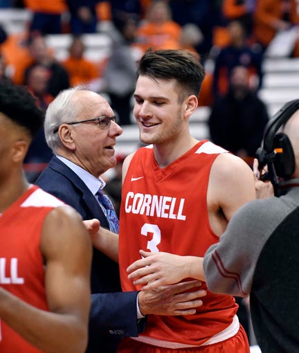 Dec 1, 2018; Syracuse, NY, USA; Syracuse Orange head coach Jim Boeheim greets his son Jimmy Boeheim (3) a forward for the Cornell Big Red after the game at the Carrier Dome. Mandatory Credit: Mark Konezny-USA TODAY Sports