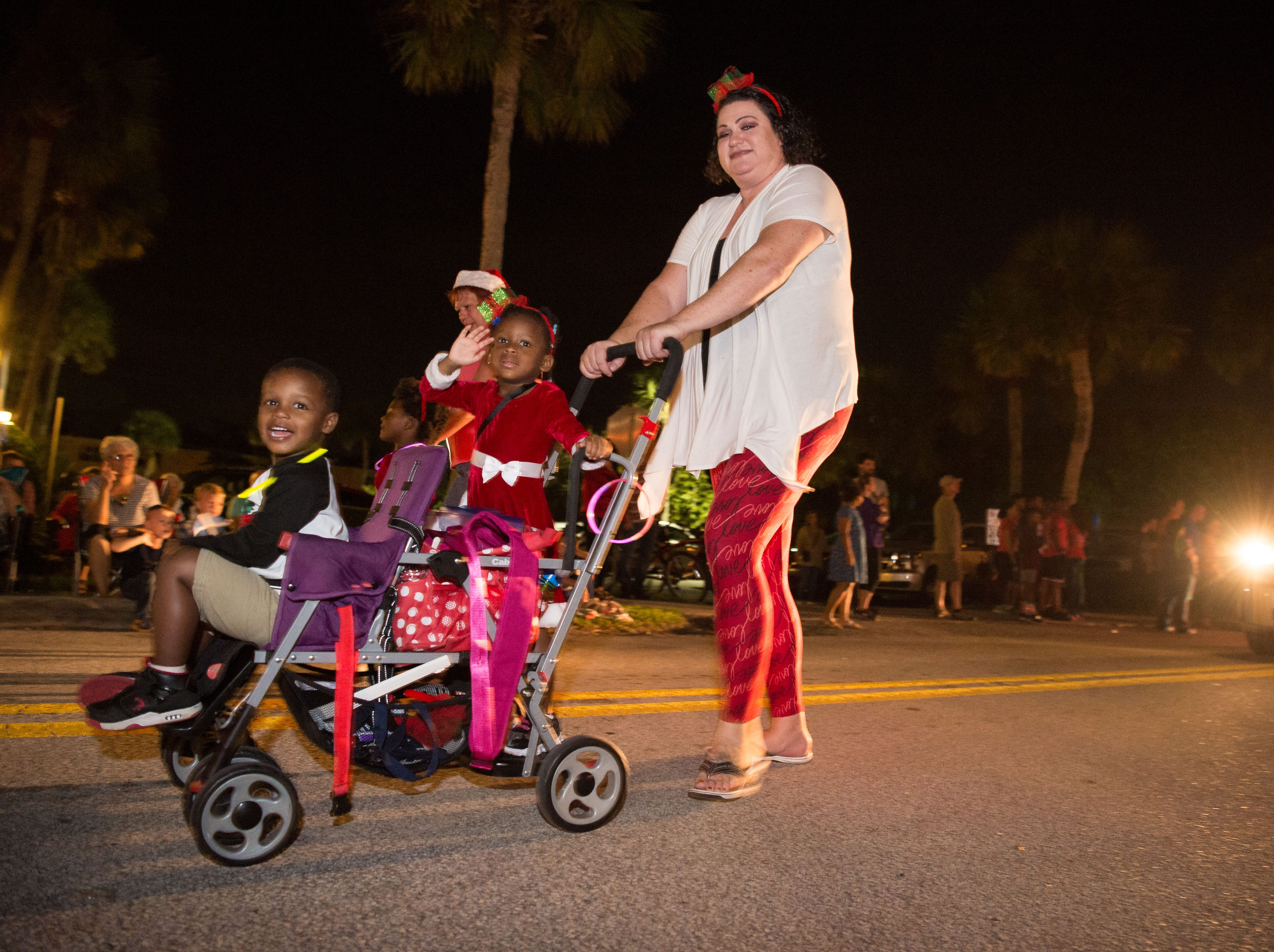Spectators and participants attend the 34th annual Centennial Christmas Parade along Ocean Drive on Saturday, Dec. 1, 2018, in Vero Beach. The fourth annual Candy Cane 3K preceded the parade.