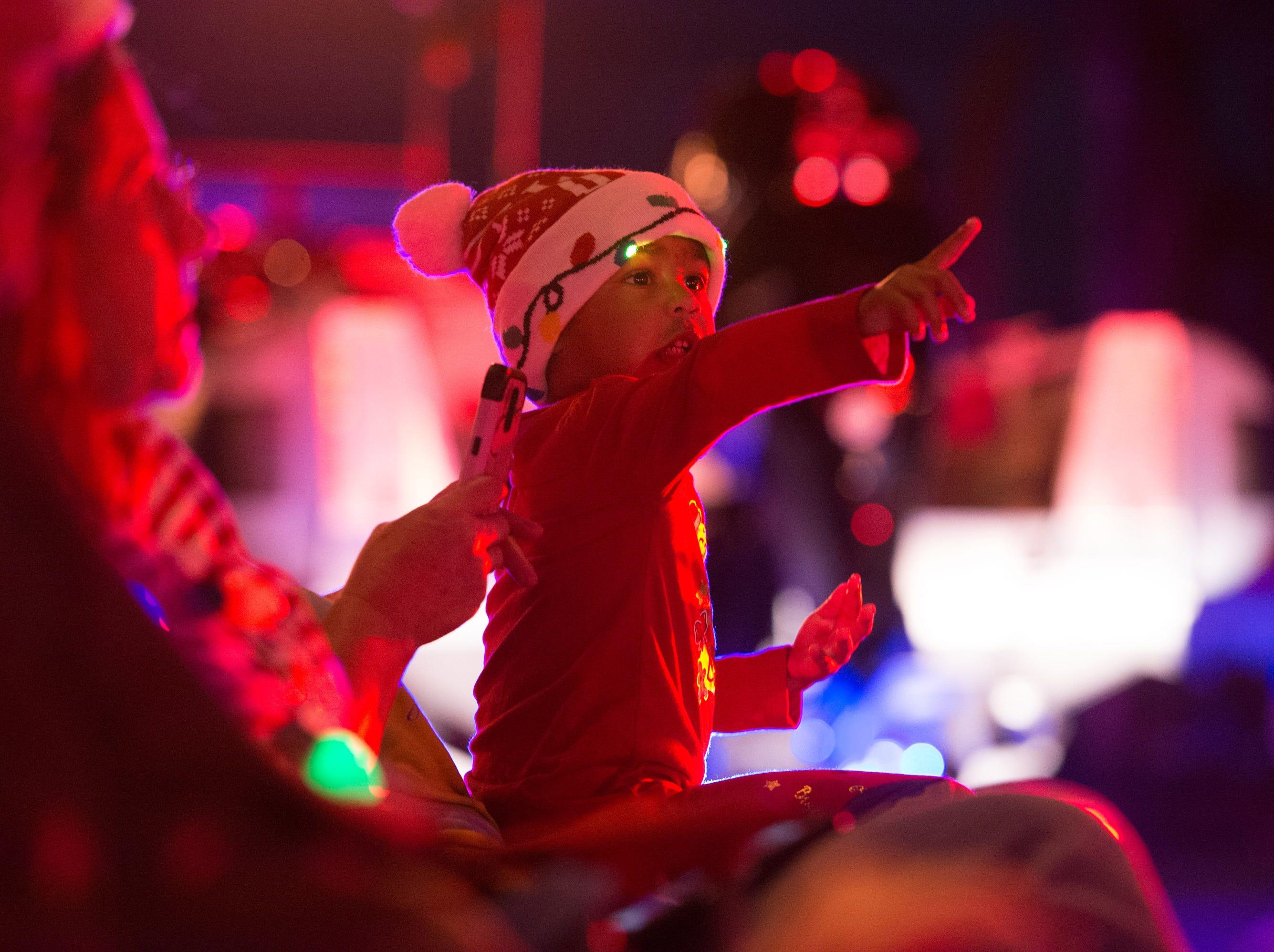 Participants and spectators celebrate the season at the Sebastian Christmas Parade on Saturday, Dec. 1, 2018, in Sebastian.
