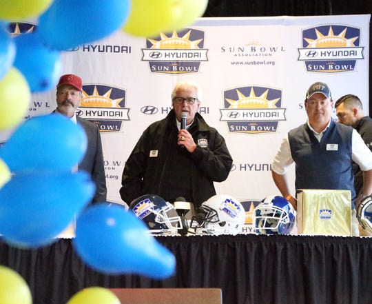 Balloons fall from above Sunday at Sunland Park Racetrack and Casino as John Folmer, center, football chairman for the Sun Bowl Association announces that Stanford will play Pitt in the 85th Hyundai Sun Bowl Game on Dec. 31.