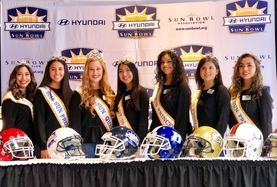 The Sun Court poses with a number of college helmets Sunday at Sunland Park Racetrack and Casino. All were possible contenders for the 85th Hyundai Sun Bowl game before officials announced the Stanford - Pitt matchup.