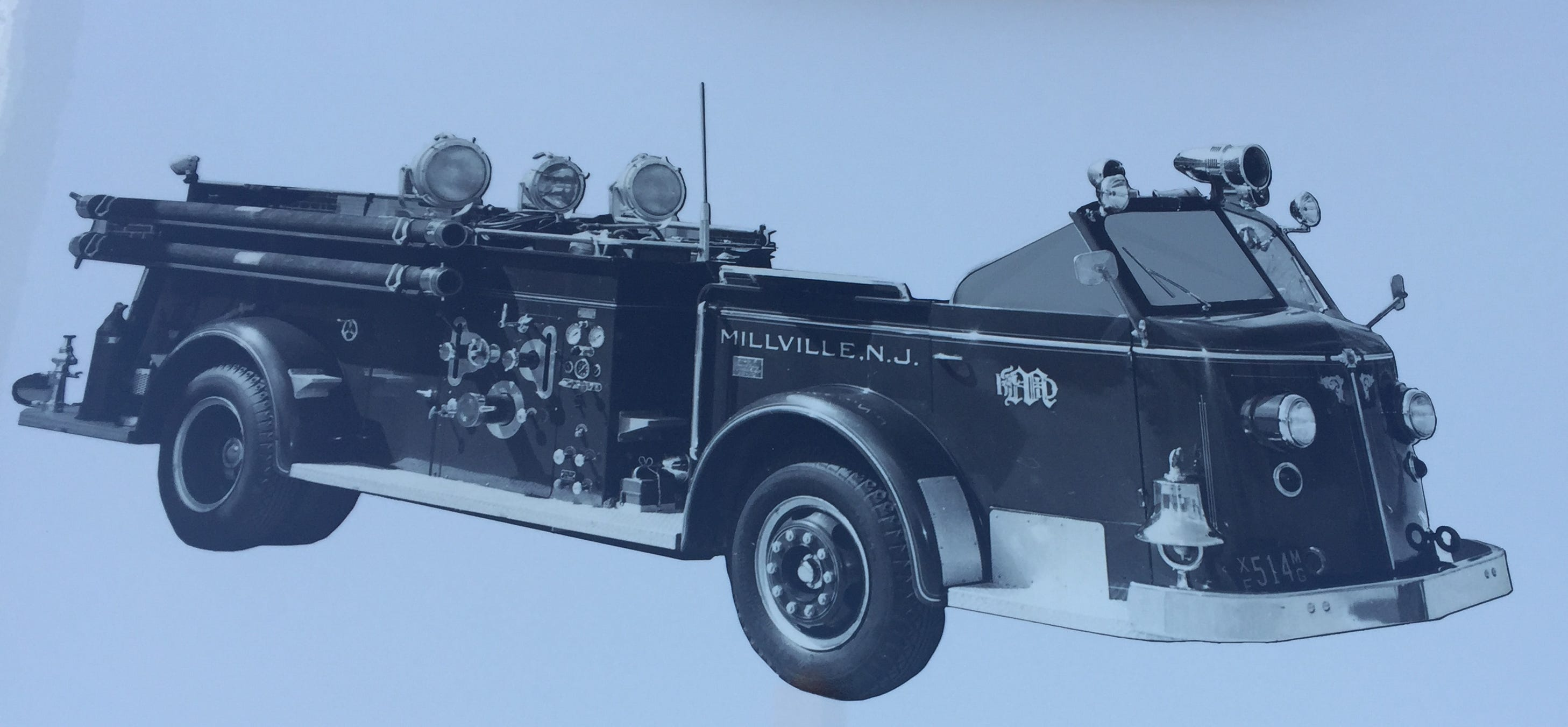 Millville Fire Department's newest engine remembers one of its predecessor with this decal. Notice the open cab.