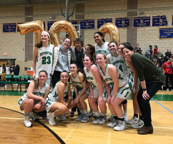 Irvington head coach Gina Maher poses with players following her 700th career win on Dec. 1, 2018.