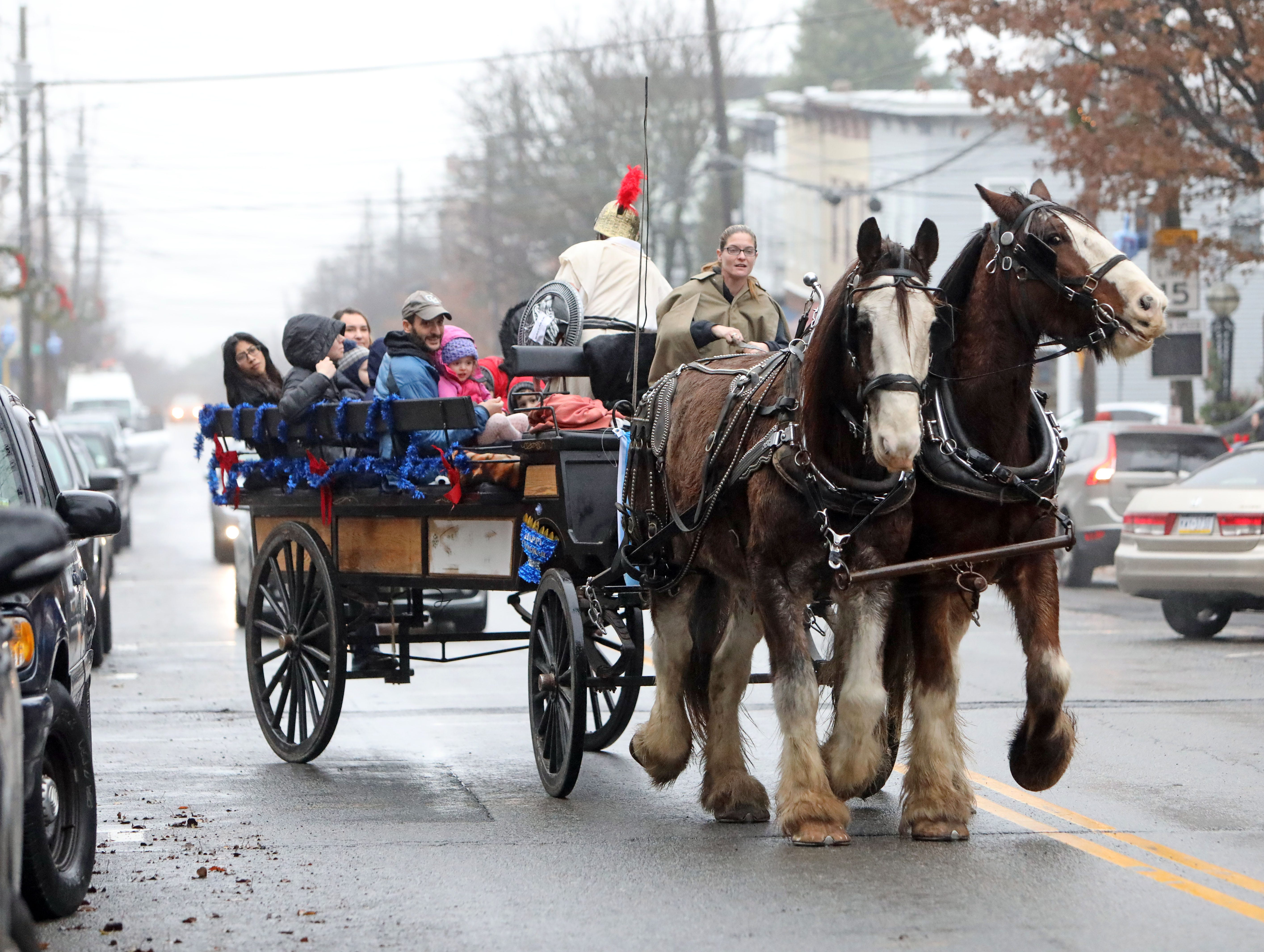 Families take a ride on the Judah Maccabee horse-drawn carriage during the Hanukkah Village event Sunday in Irvington sponsored by the Chabad of the Rivertowns