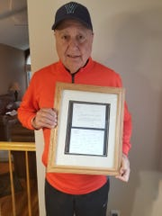 John Viniello, 76, of Brewster, has a keepsake from his work on George H.W. Bush's unsuccessful 1980 presidential campaign: a handwritten note from the candidate.
