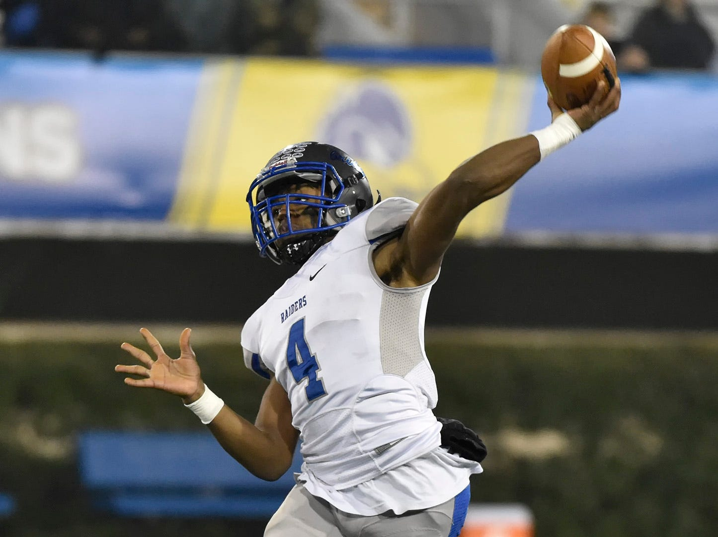Woodbridge's Troy Haynes (4) with a pass attempt in the DIAA Division II State High School Football Championship game at the University of Delaware.