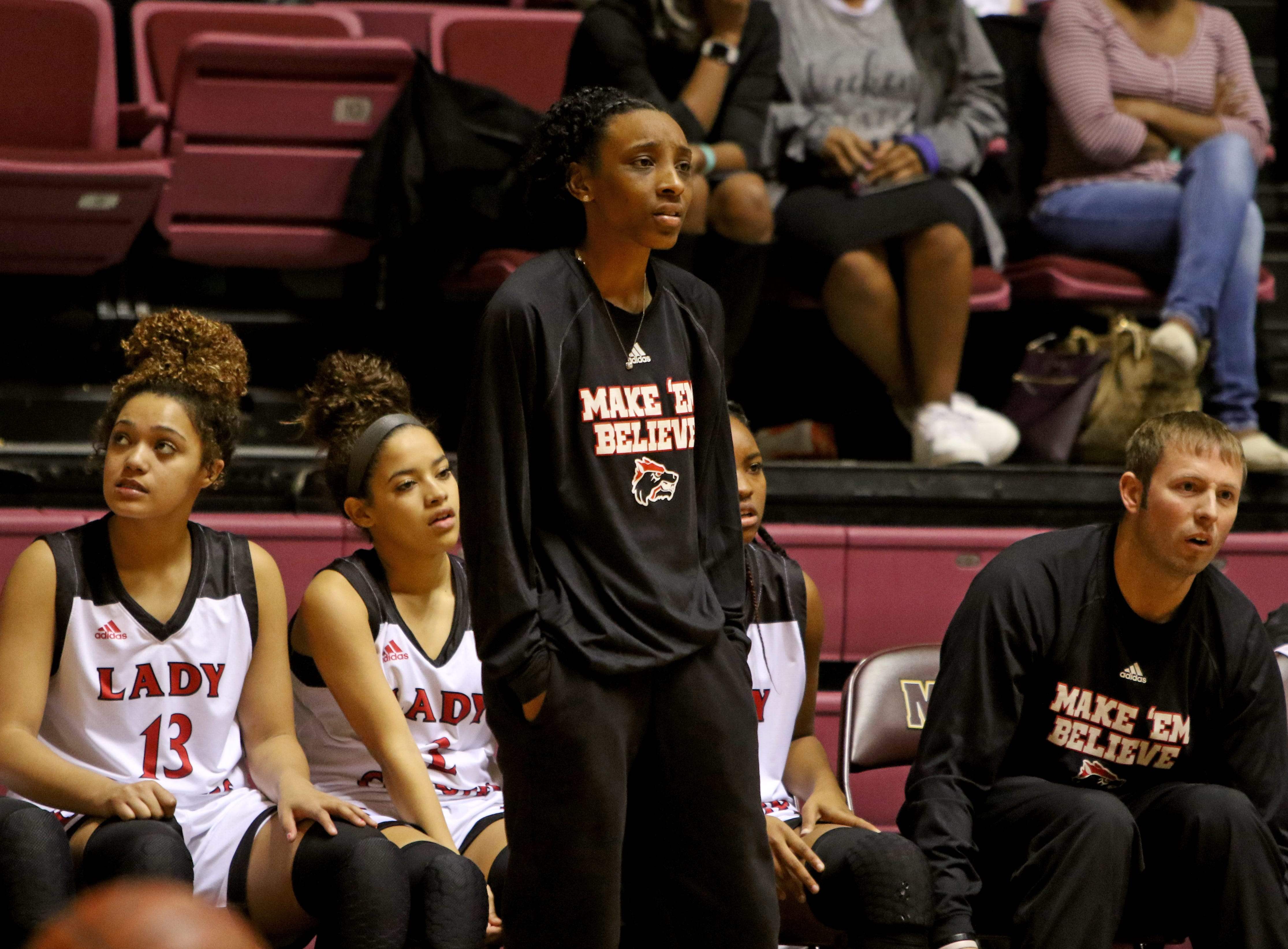 Wichita Falls High School head basketball coach Bri Brooks watches her team in the game against Hirschi Saturday, Dec. 1, 2018, at D.L. Ligon Coliseum at Midwestern State University.
