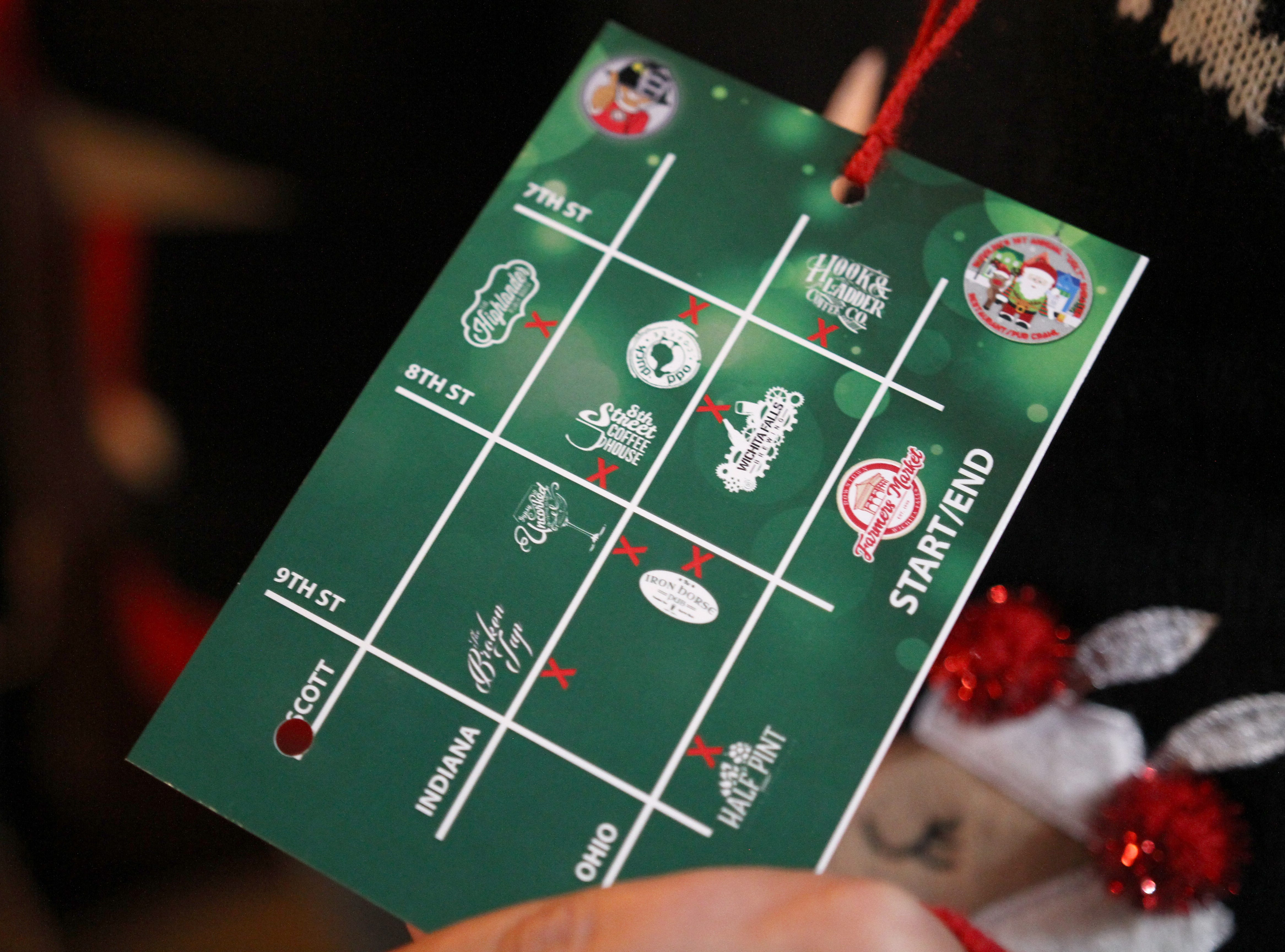 Many people on Rudolph's First Ugly Sweater Crawl wore cards that were punched at each stop Saturday, Dec. 1, 2018, in Downtown Wichita Falls.
