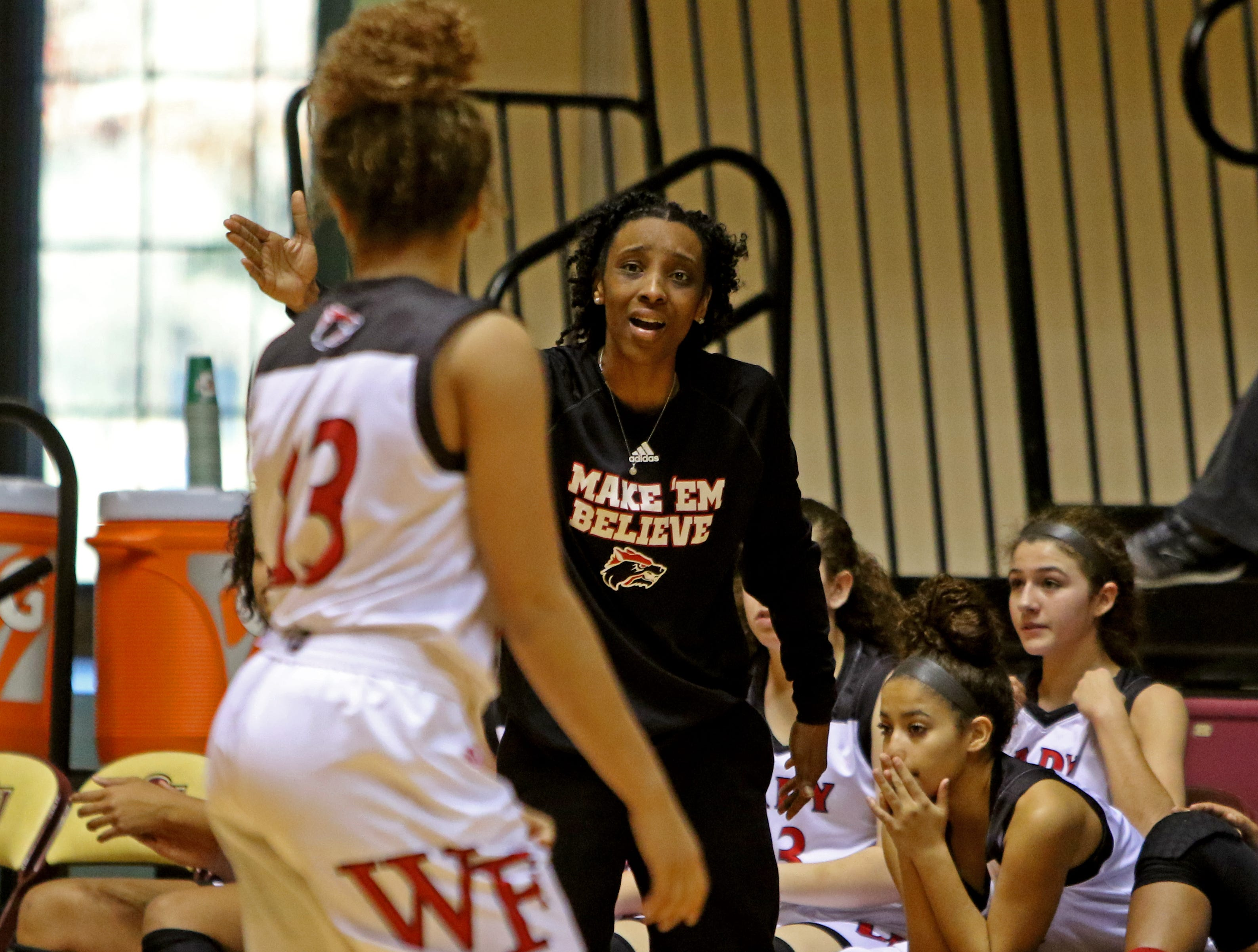 Wichita Falls High School head basketball coach Bri Brooks yells to her players in the game against Hirschi Saturday, Dec. 1, 2018, at D.L. Ligon Coliseum at Midwestern State University.