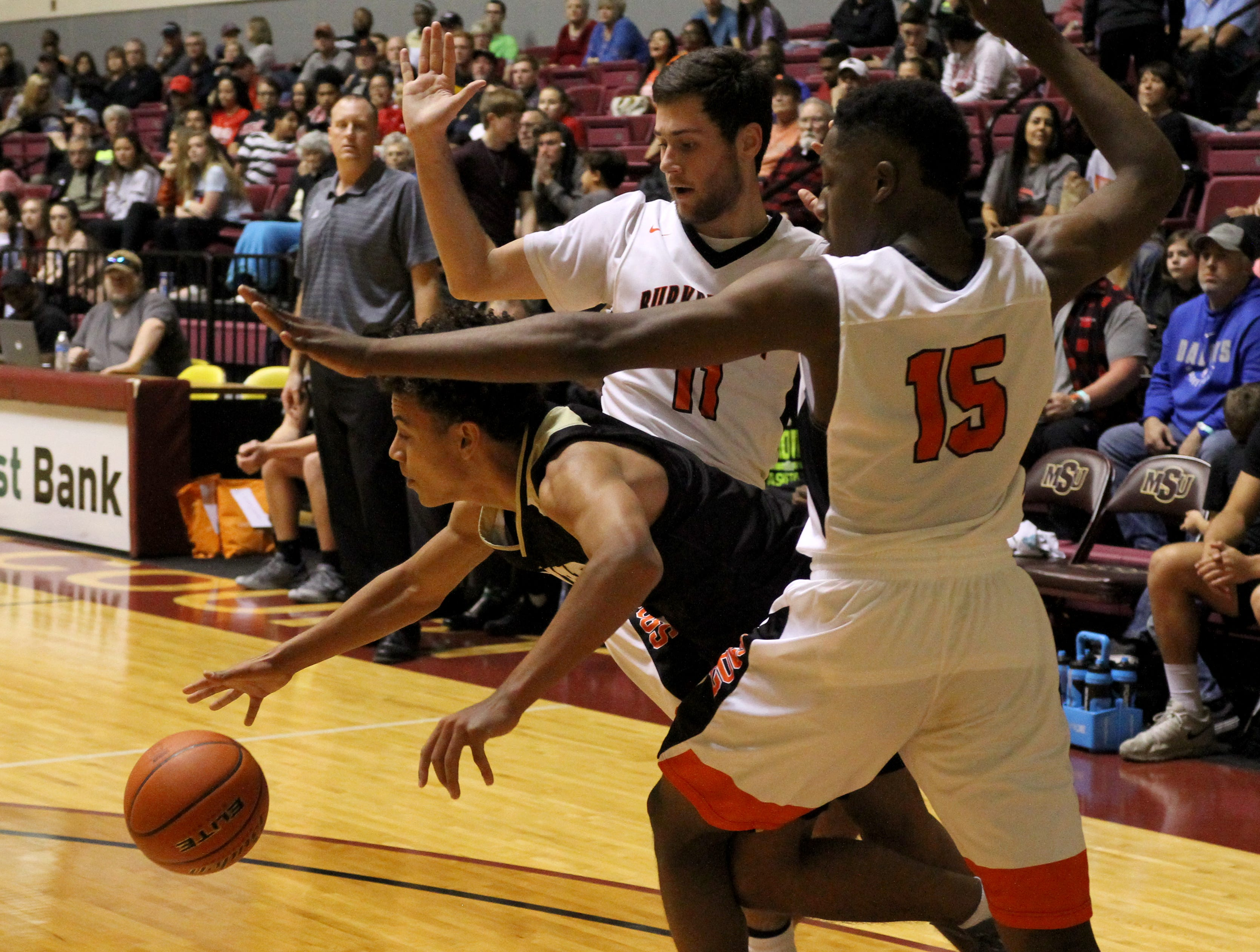 Rider's Kellar Owens gets away from Burkburnett's Gavin Morris (11) and Doriean Smith (15) but losses the ball in the Wichita Falls Classic Saturday, Dec. 1, 2018, in D.L. Ligon Coliseum at Midwestern State University.