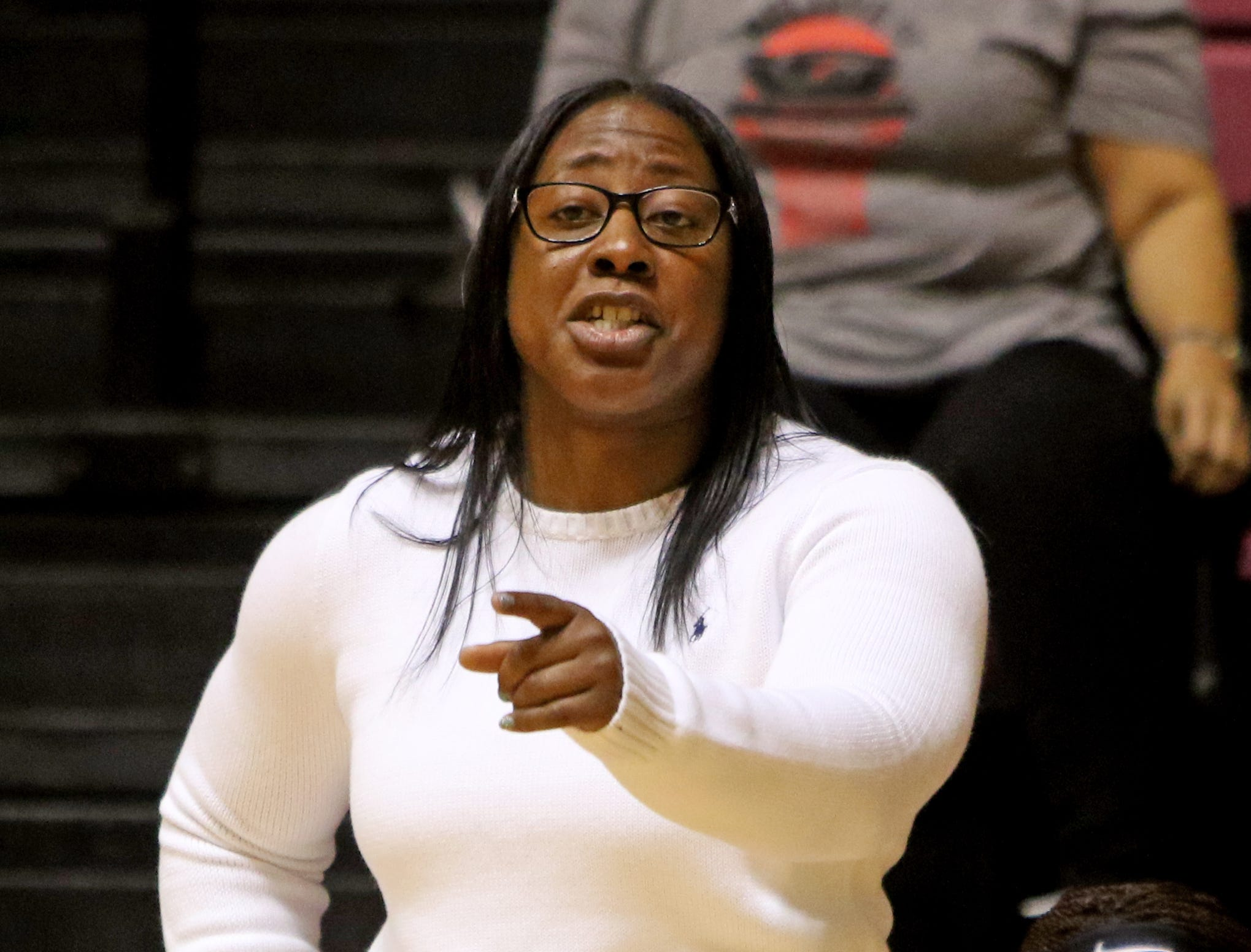 Hirschi head basketball coach KraTaura Buckner talks to her players in the game against Wichita Falls High School Saturday, Dec. 1, 2018, at D.L. Ligon Coliseum at Midwestern State University.