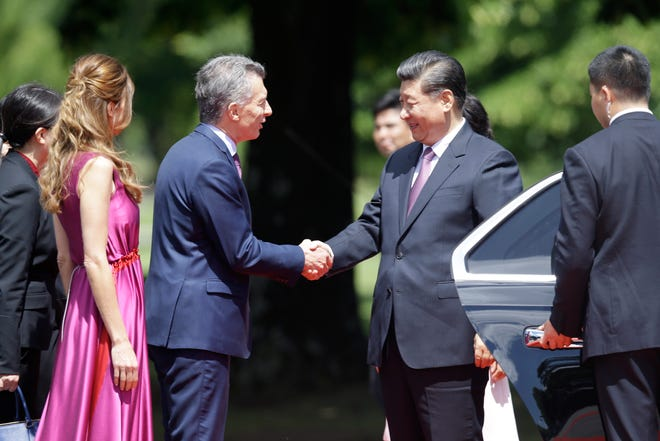 Argentina's President Mauricio Macri and first lady Juliana Awada welcome China's President Xi Jinping at presidential residence in Olivos, a northern suburb of Buenos Aires, Argentina, Sunday, Dec. 2, 2018.