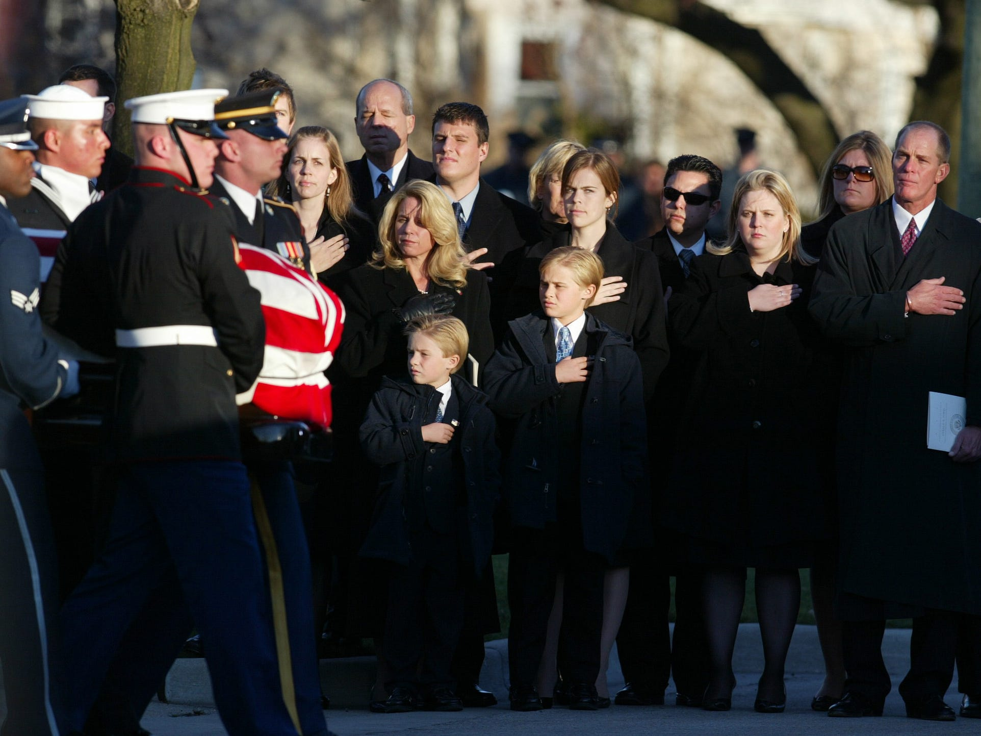 The family of former President Gerald Ford watches has his casket is loaded into a hearse following a funeral service Wednesday, Jan. 3, 2007, at Grace Episcopal Church in Grand Rapids, Mich.