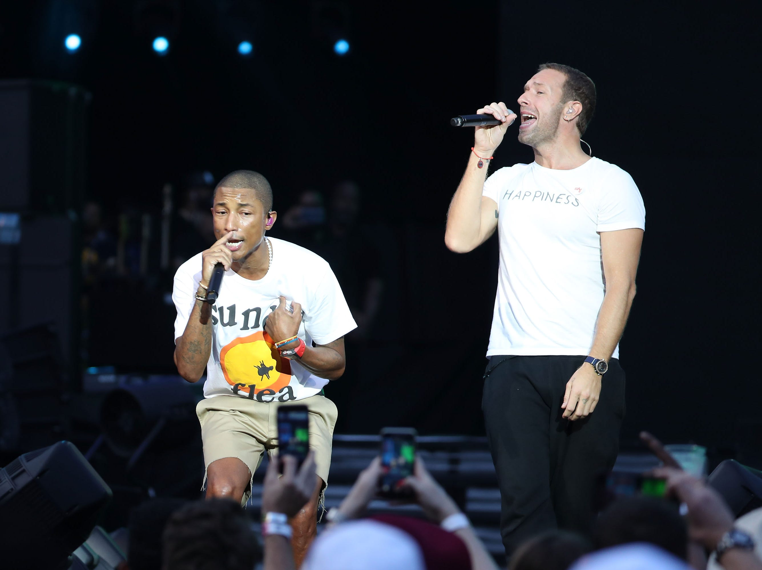 JOHANNESBURG, SOUTH AFRICA - DECEMBER 02:  Pharrell Williams and Chris Martin perform during the Global Citizen Festival: Mandela 100 at FNB Stadium on December 2, 2018 in Johannesburg, South Africa.  (Photo by Jemal Countess/Getty Images for Global Citizen Festival: Mandela 100) ORG XMIT: 775264426 ORIG FILE ID: 1067682516