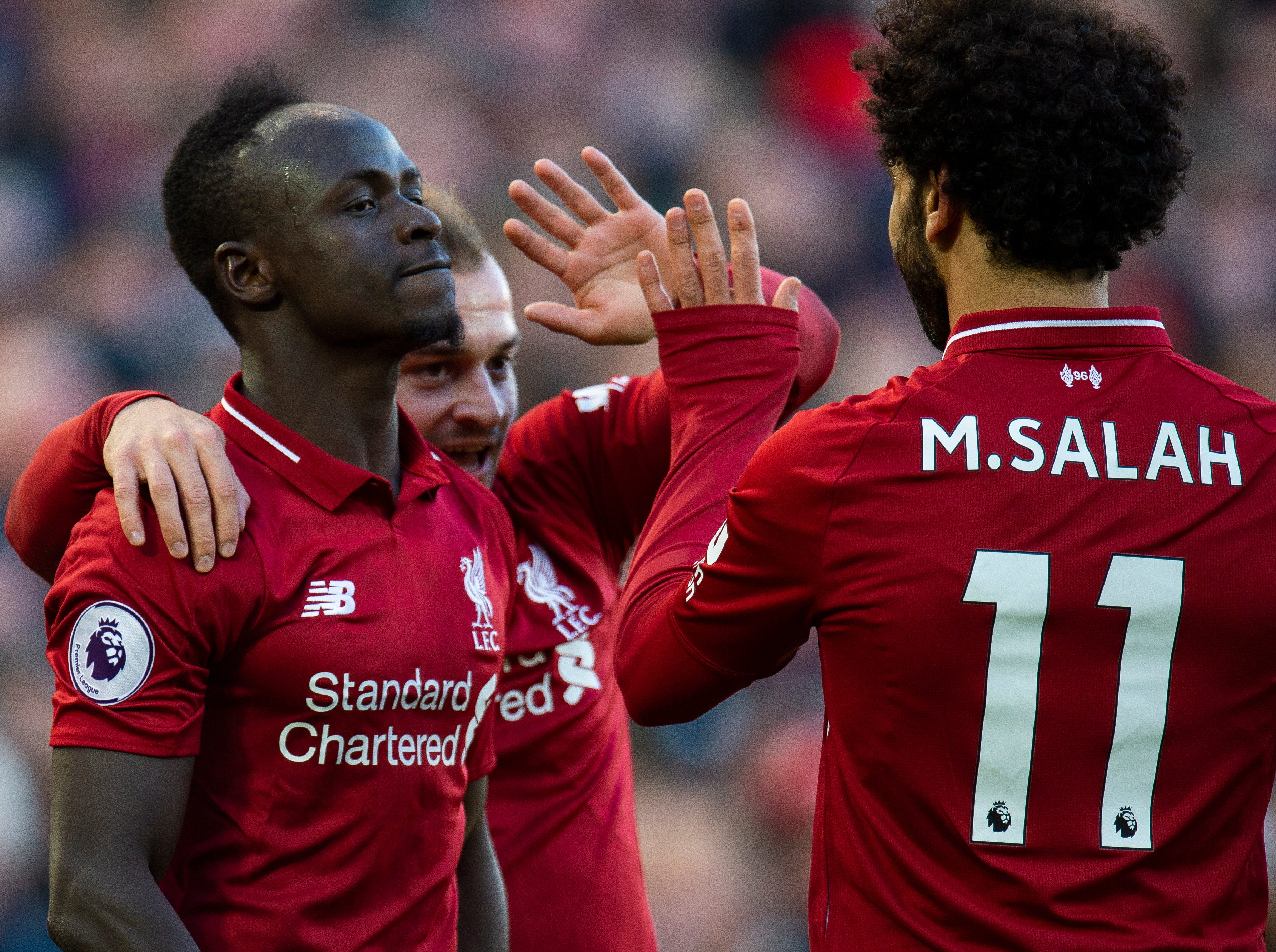Liverpool's Mohamed Salah is congratulated by his teammates after scoring the fifth goal against Cardiff.