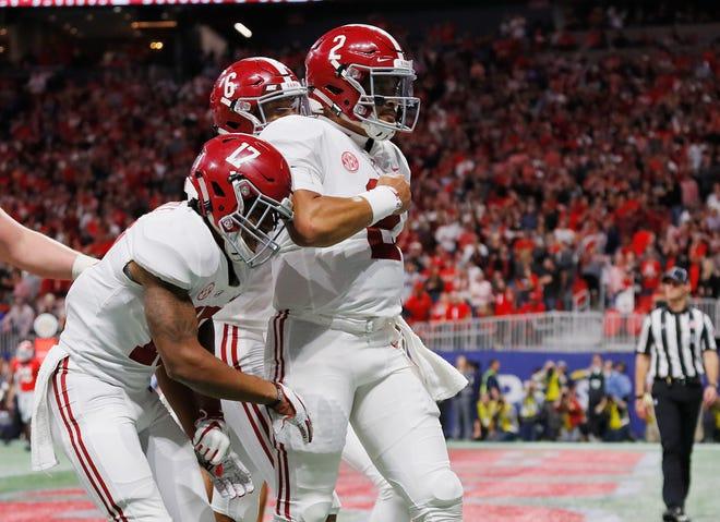 Alabama quarterback Jalen Hurts (2 ) celebrates after scoring the go-ahead touchdown.