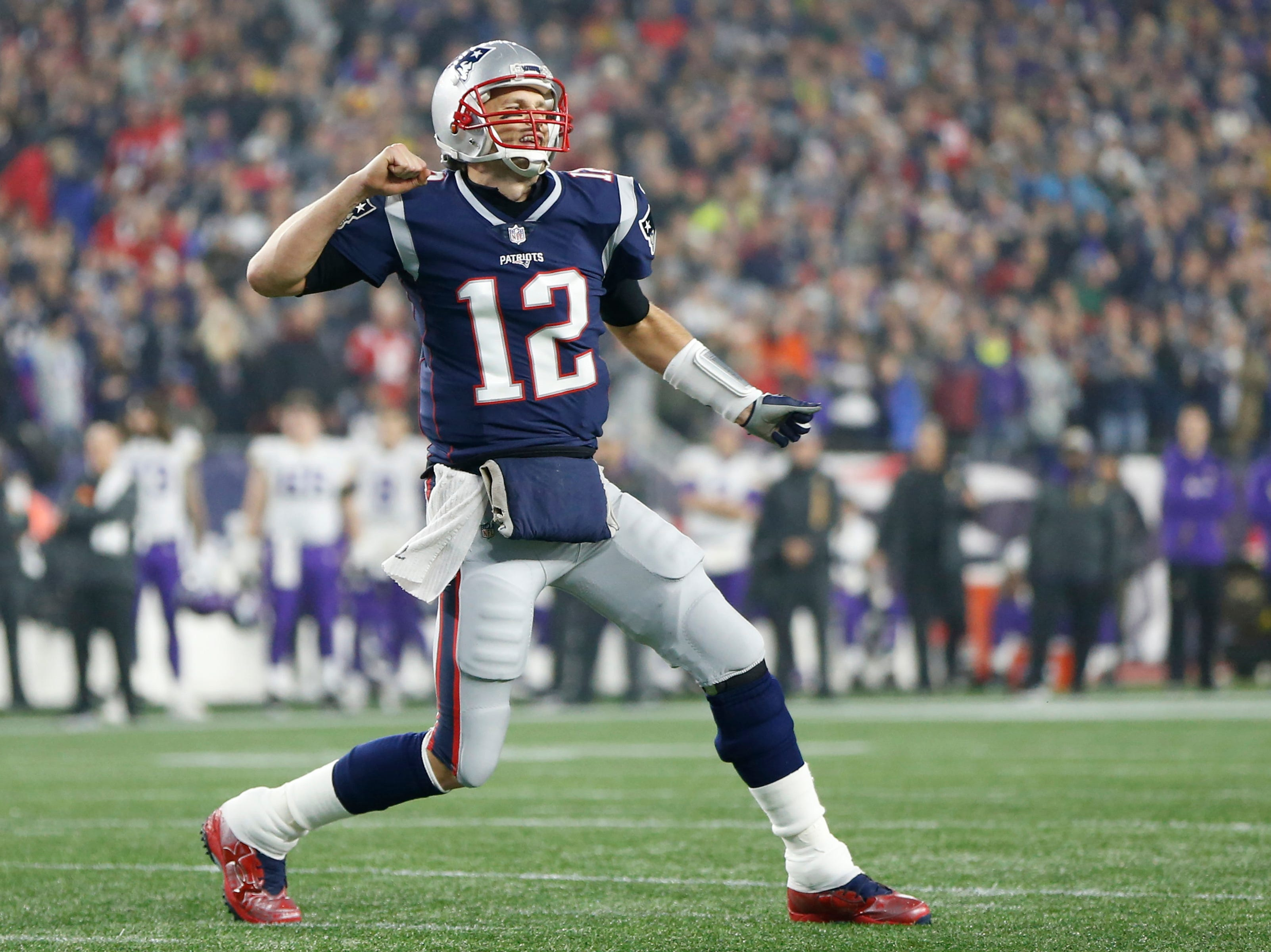 Tom Brady reacts after a touchdown in the first quarter against the Vikings.