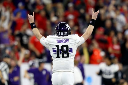 Northwestern Wildcats quarterback Clayton Thorson reacts to the touchdown run by running back John Moten IV against the Ohio State Buckeyes.