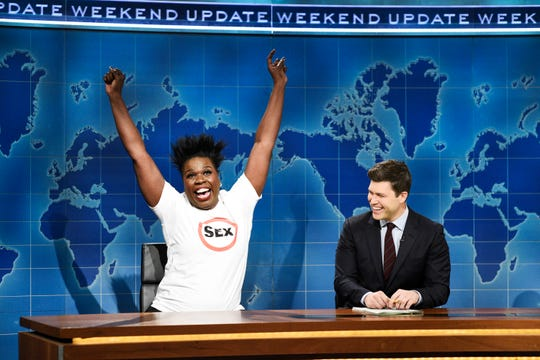 "Leslie Jones, left, announces her un-retirement from sex, as ""Weekend Update"" anchor Colin Jost listens, on ""Saturday Night Live."""