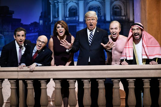 "That wasn't the only musical parody. During the G20-themed cold open,  President Trump (Alec Baldwin), third from right, is joined by Michael Cohen (Ben Stiller), left, Rudy Giuliani (Kate McKinnon), Melania Trump (Cecily Strong), Vladimir Putin (Beck Bennett) and Saudi Prince Mohammed bin Salman (Fred Armisen) sent up the Broadway staple ""Don't Cry for Me, Argentina."""