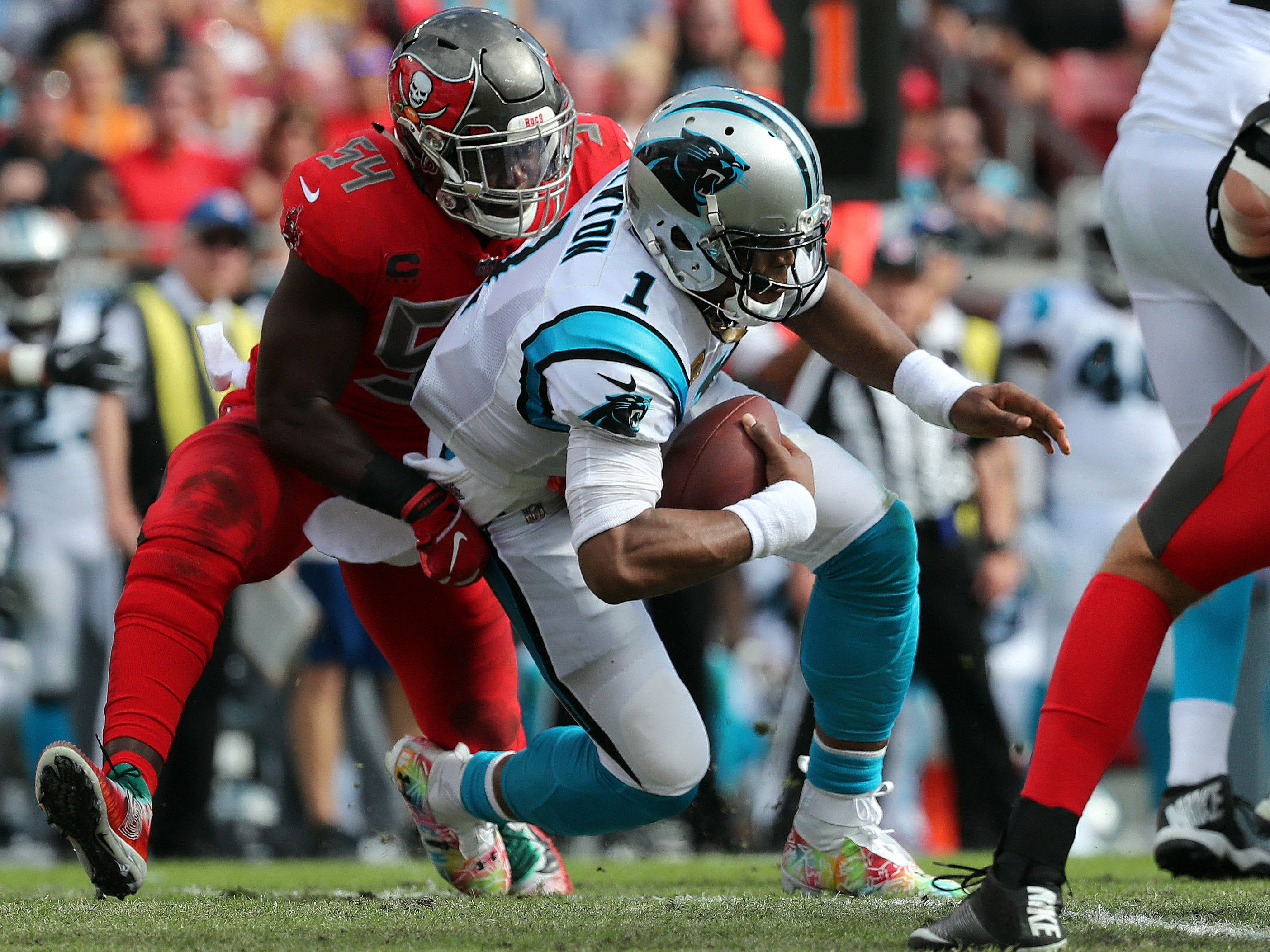 Tampa Bay Buccaneers outside linebacker Lavonte David (54) sacks Carolina Panthers quarterback Cam Newton (1) during the first half at Raymond James Stadium.