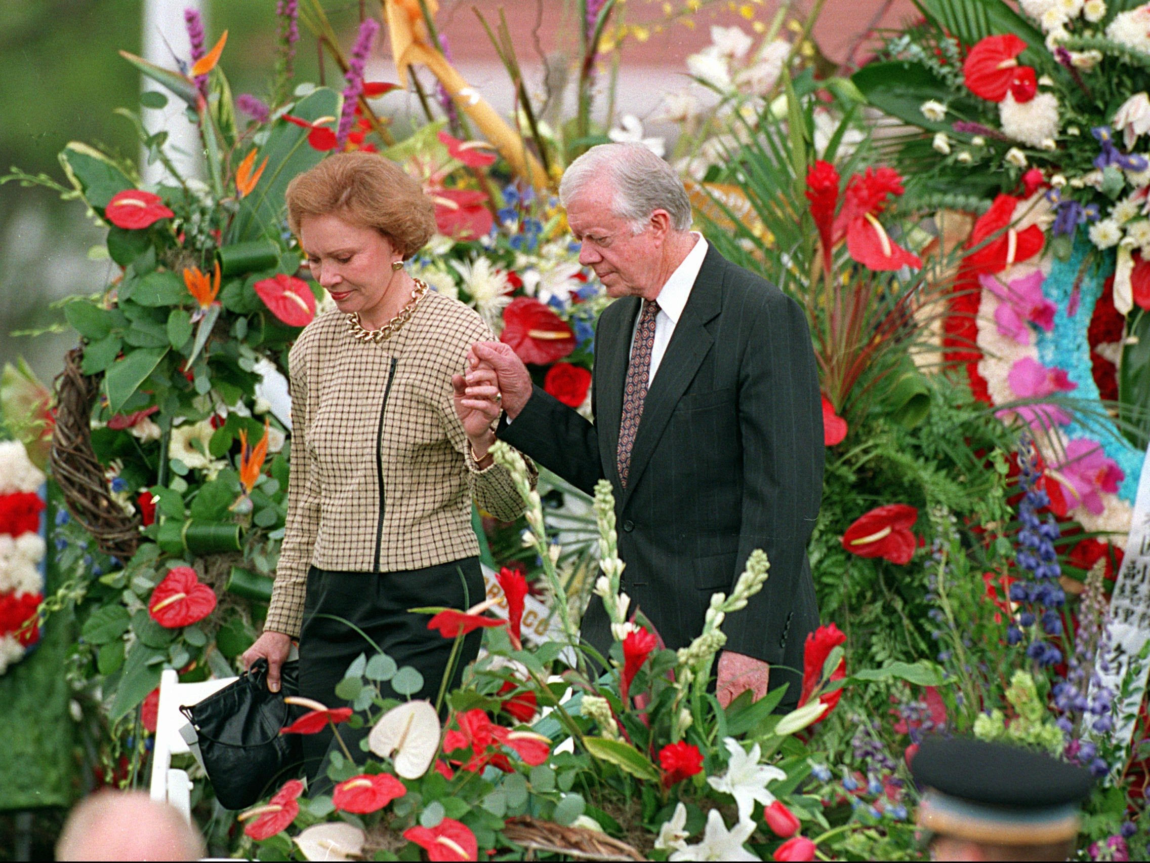 Former President Jimmy Carter and his wife Rosalynn attend the funeral of Richard Nixon, April 27, 1994, in Yorba Linda, Calif.