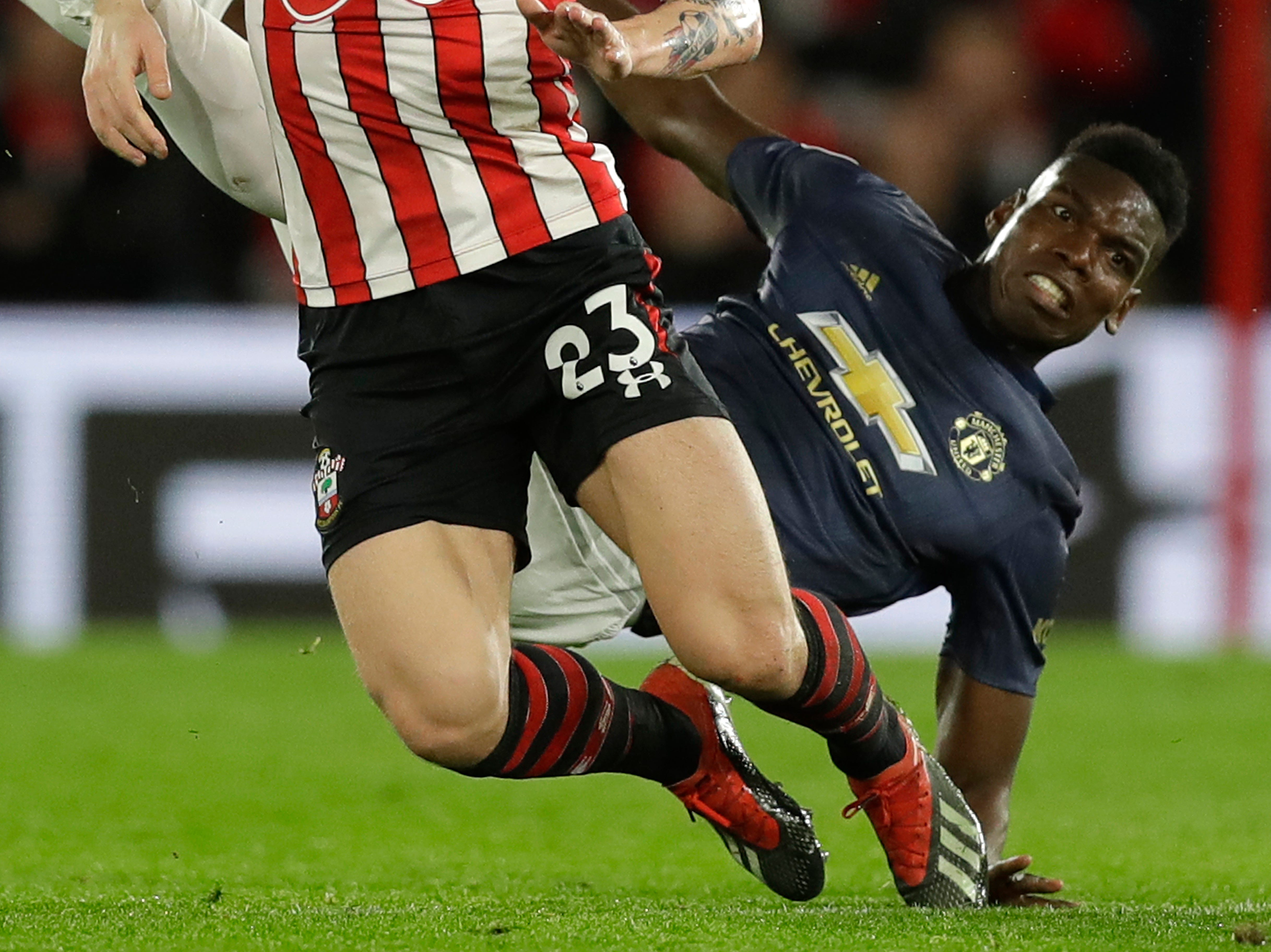 Manchester United's Paul Pogba, right, fights for the ball with Southampton's Pierre-Emile Hojbjerg.