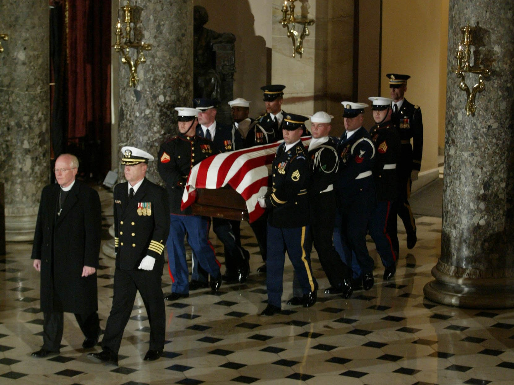 The casket of former President Gerald R. Ford is escorted through the National Statuary Hall inside the Capitol in Washington on Saturday, Dec. 30, 2006.