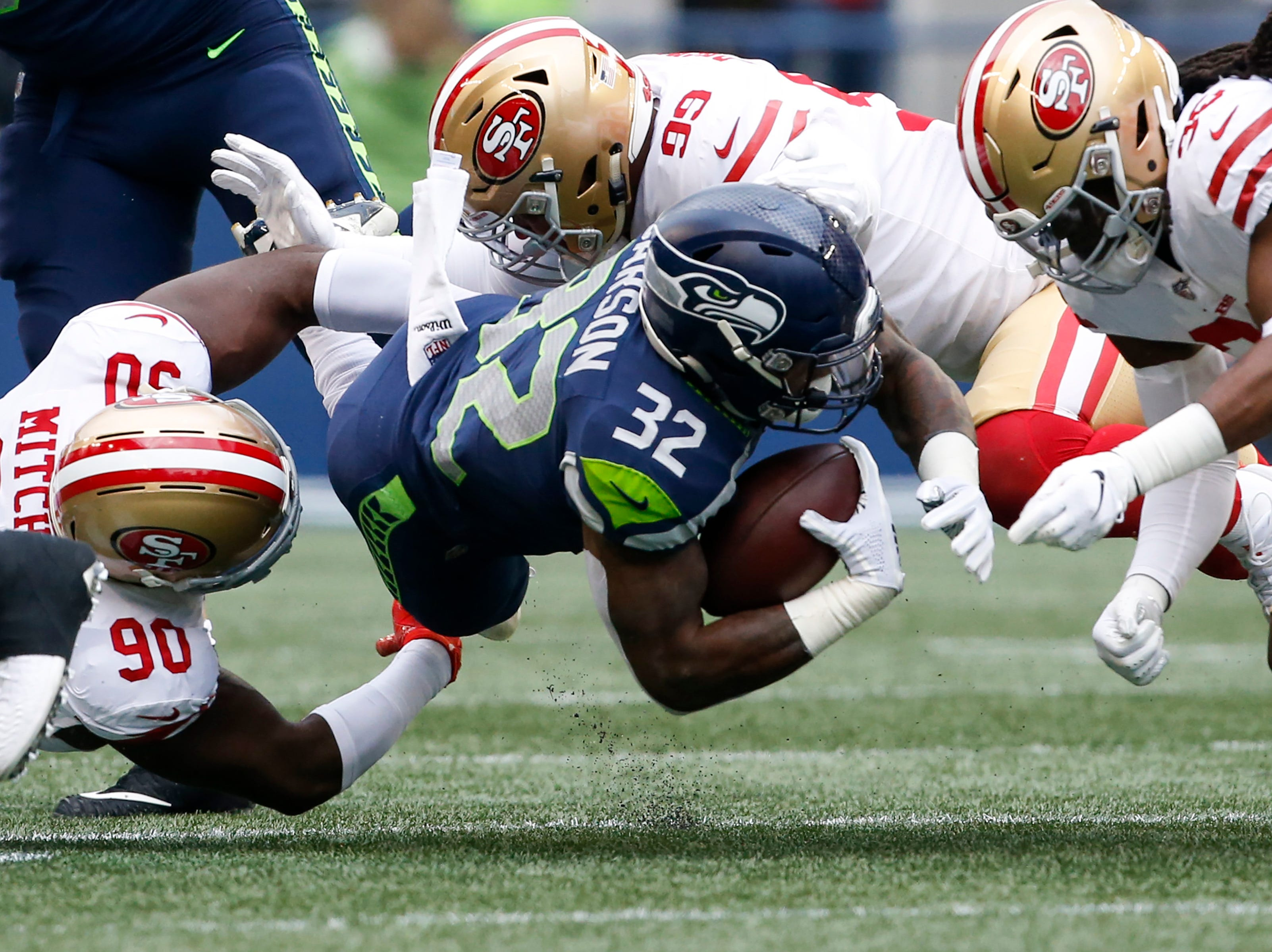 Seahawks running back Chris Carson rushes in the first quarter against the 49ers.