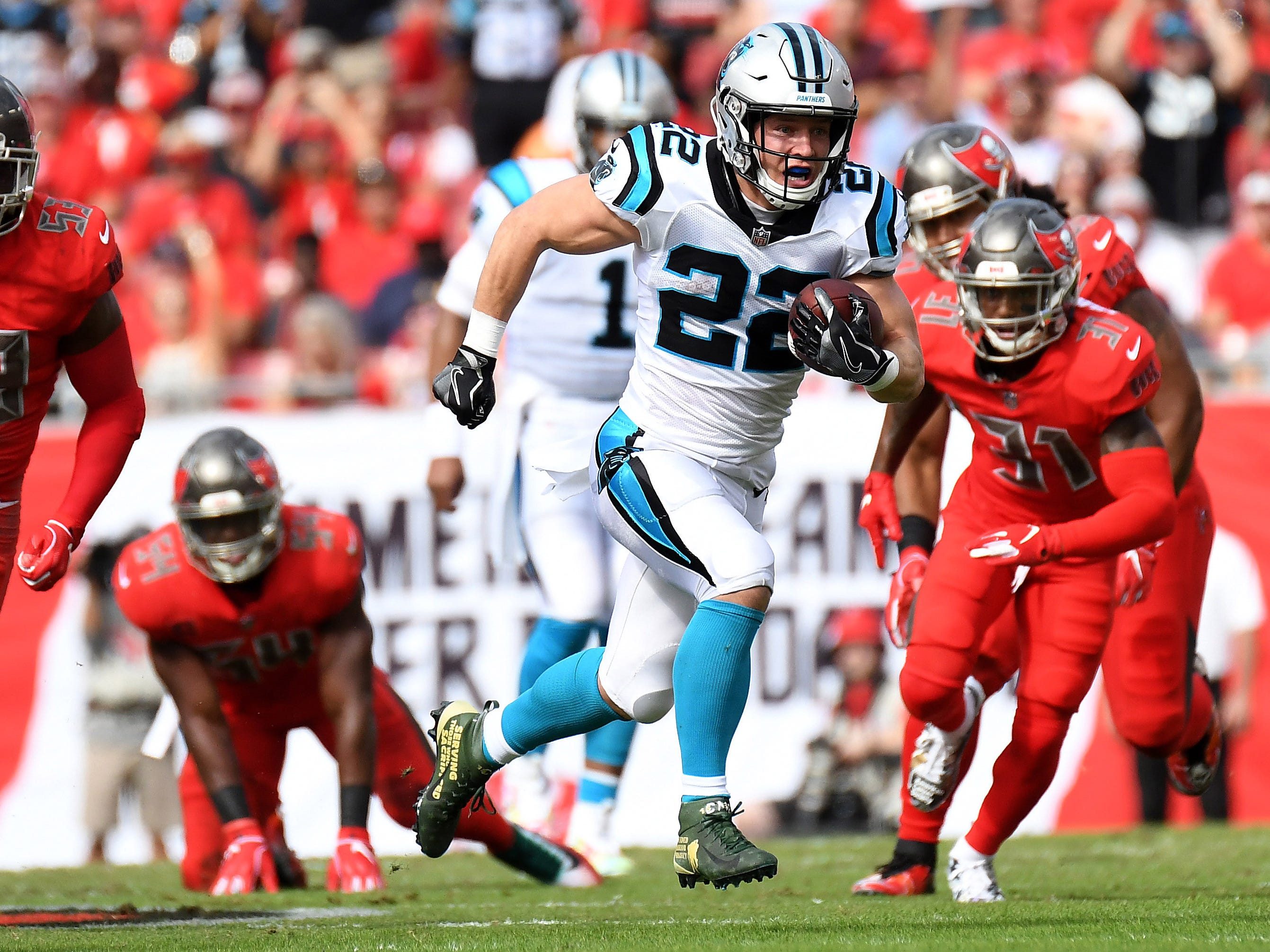Carolina Panthers running back Christian McCaffrey (22)  runs the ball  in the first half against the Tampa Bay Buccaneers at Raymond James Stadium.