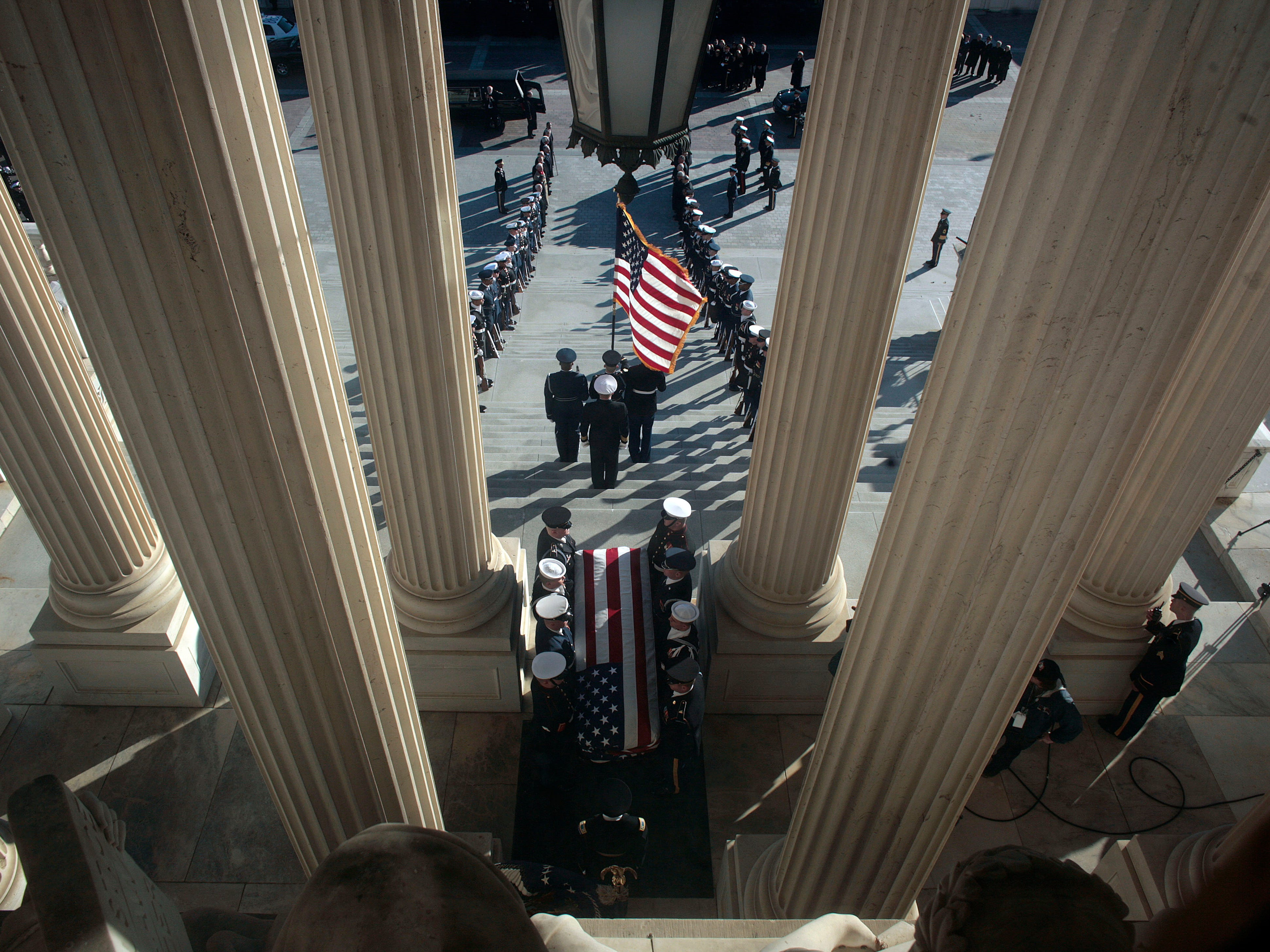 Former President Gerald Ford's casket is carried from the U.S. Capitol en route to a funeral at the Washington National Cathedral in Washington, Tuesday, Jan. 2, 2007.
