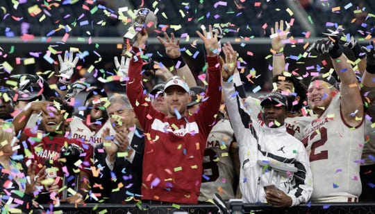 Oklahoma coach Lincoln Riley holds up the championship trophy after the Sooners beat Texas in the 2018 Big 12 championship game.