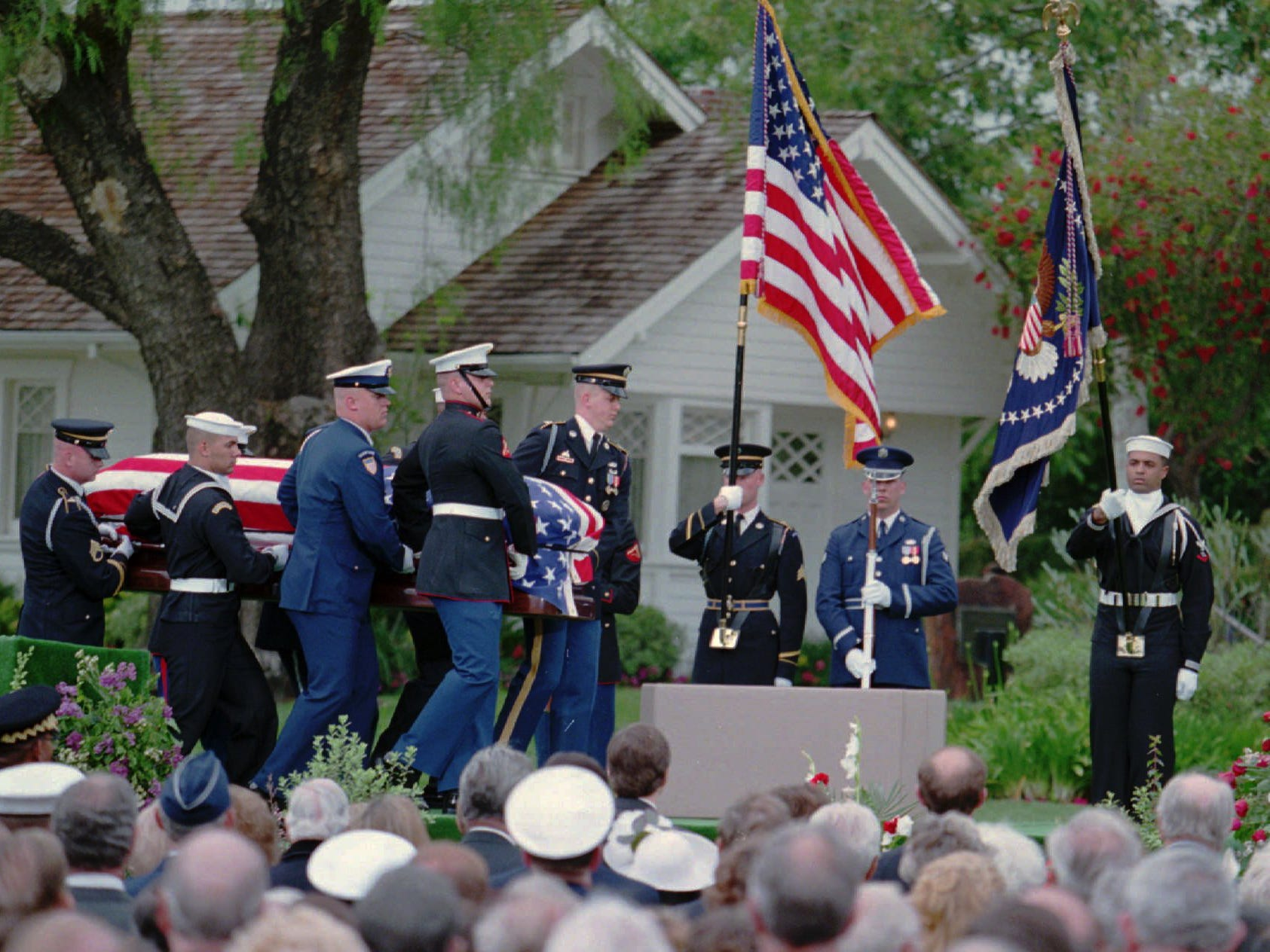 The casket of Richard Nixon is delivered to funeral services by a military honor guard at the Nixon Library in Yorba Linda, Calif., on April 27, 1994.