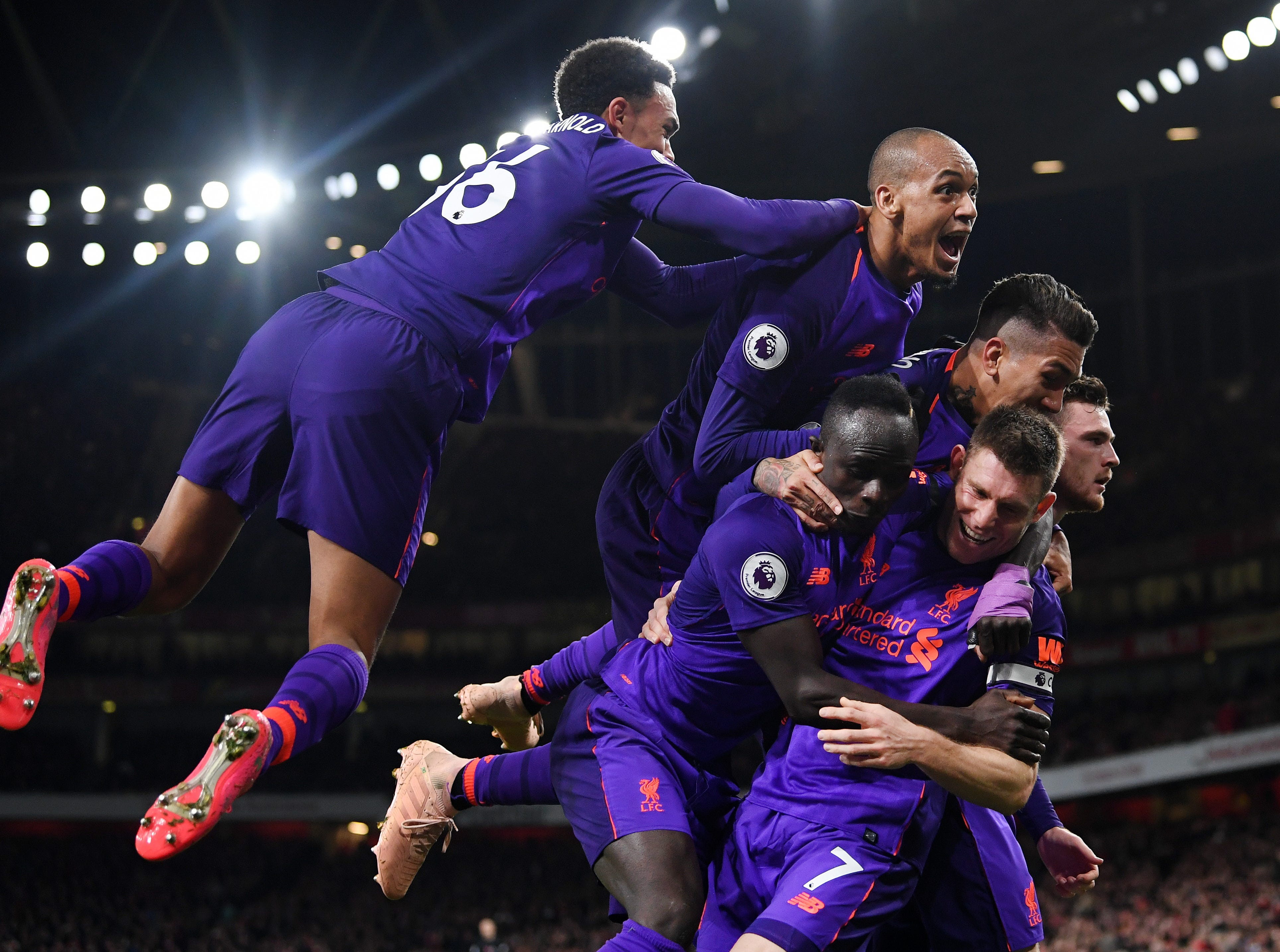 Liverpool celebrates scoring the hopenign goal against Arsenal.