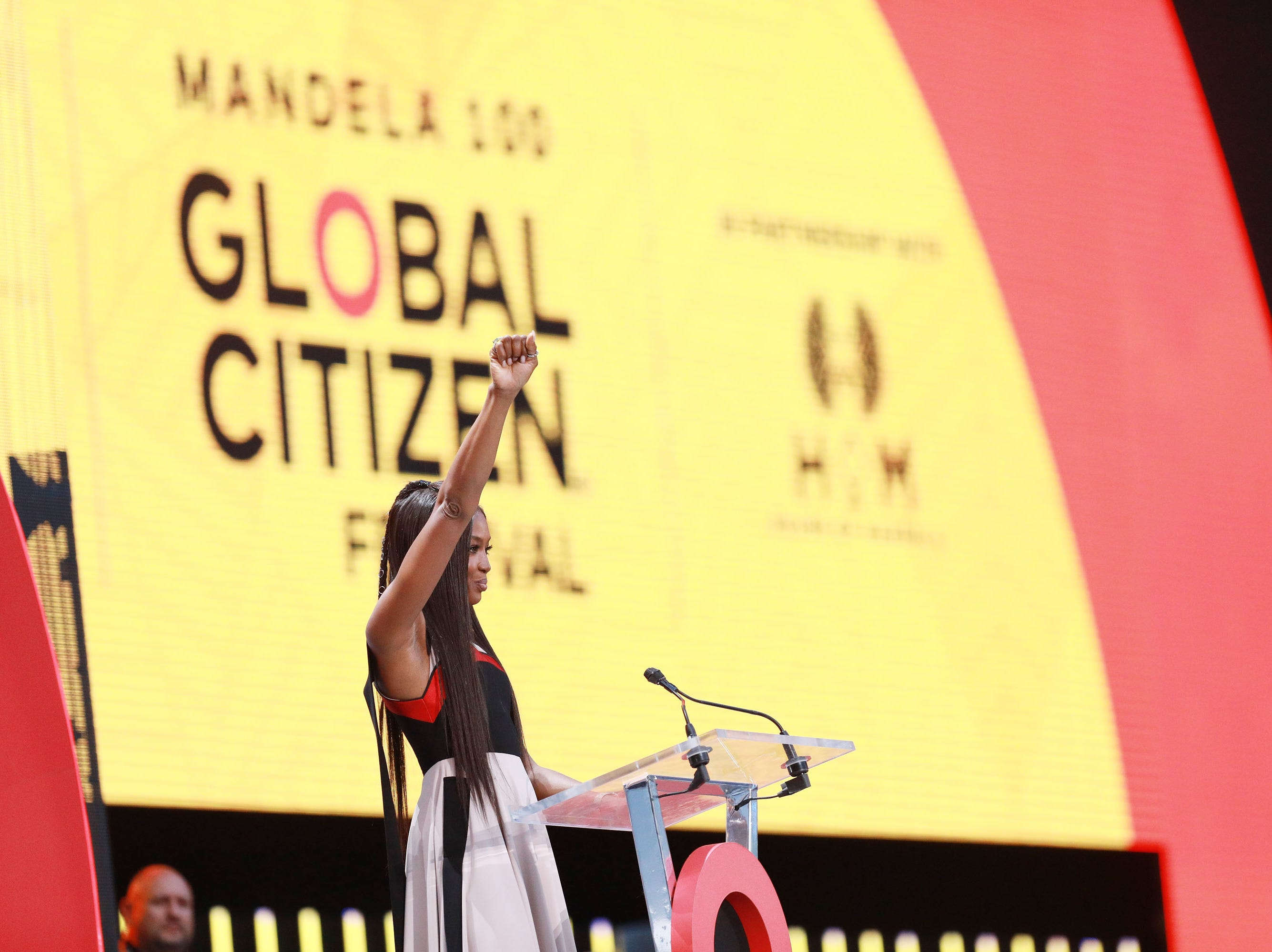 JOHANNESBURG, SOUTH AFRICA - DECEMBER 02: Naomi Campbell speaks on stage during the Global Citizen Festival: Mandela 100 at FNB Stadium on December 2, 2018 in Johannesburg, South Africa.  (Photo by Michelly Rall/Getty Images for Global Citizen Festival: Mandela 100) ORG XMIT: 775264426 ORIG FILE ID: 1067716302