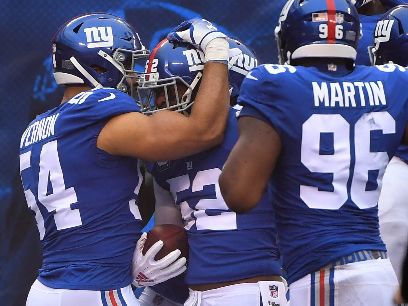 New York Giants linebacker Alec Ogletree (52) after intercepting a pass off of Chicago Bears quarterback Chase Daniel (4) in the first series for a touchdown at MetLife Stadium.