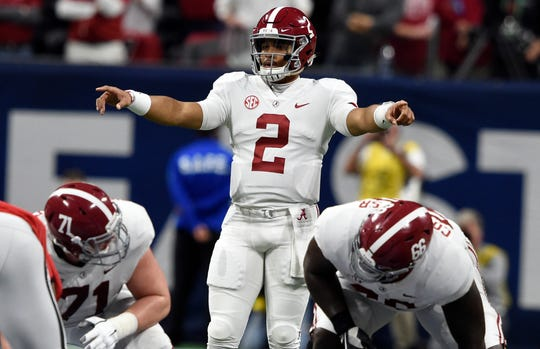 Alabama quarterback Jalen Hurts stands at the line of scrimmage during his team's game against Georgia in the SEC championship game.
