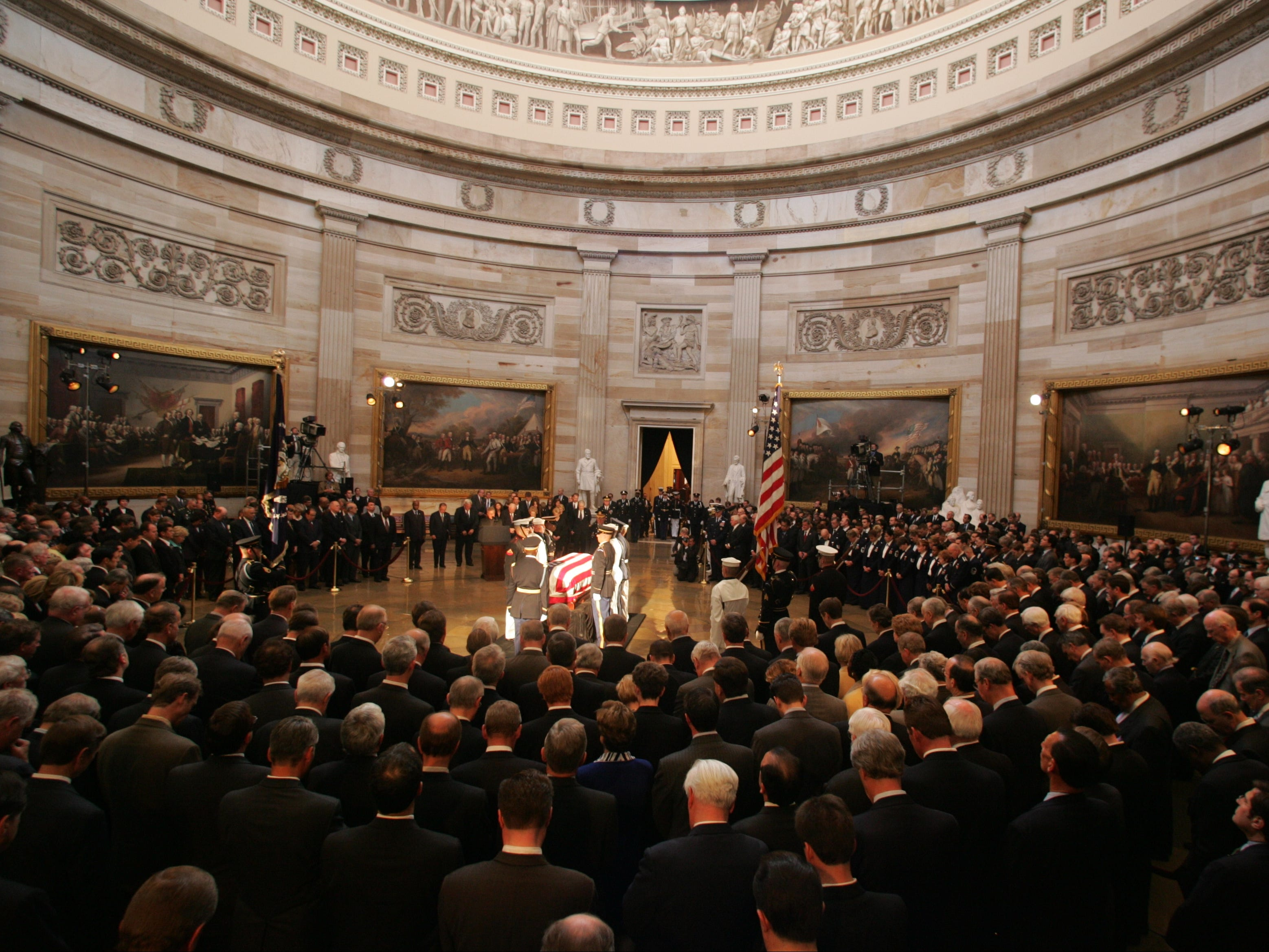 President Ronald Reagan's casket is bathed in light during a service in the Rotunda of the Capitol, June 9, 2004.