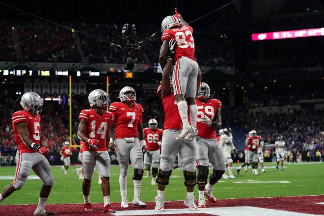 Ohio State Buckeyes wide receiver Terry McLaurin (83) celebrates with teammates after scoring a touchdown against the Northwestern Wildcats in the first half in the Big Ten conference championship game at Lucas Oil Stadium.