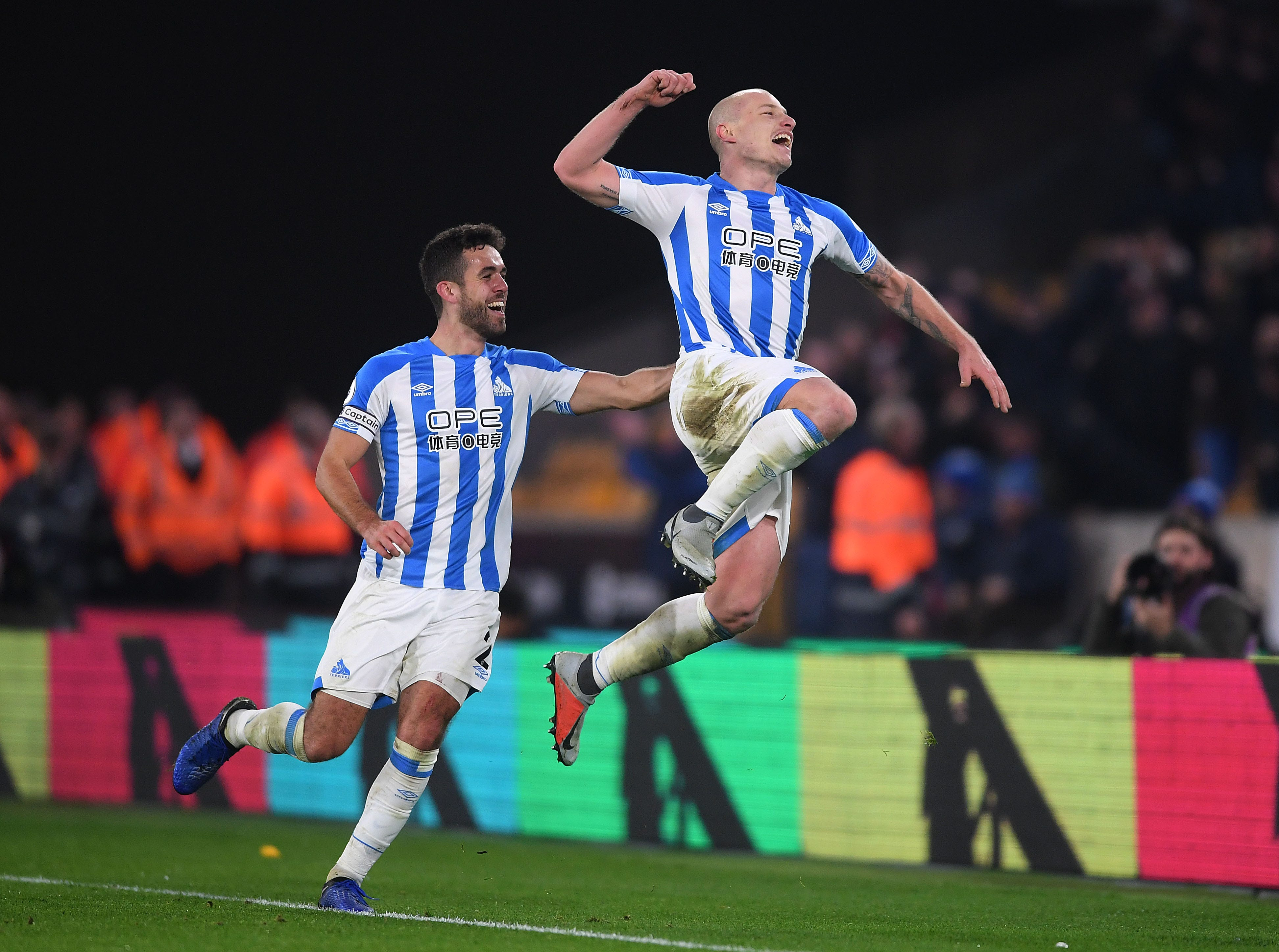 Aaron Mooy of Huddersfield celebrates after scoring his team's second goal against Wolves.