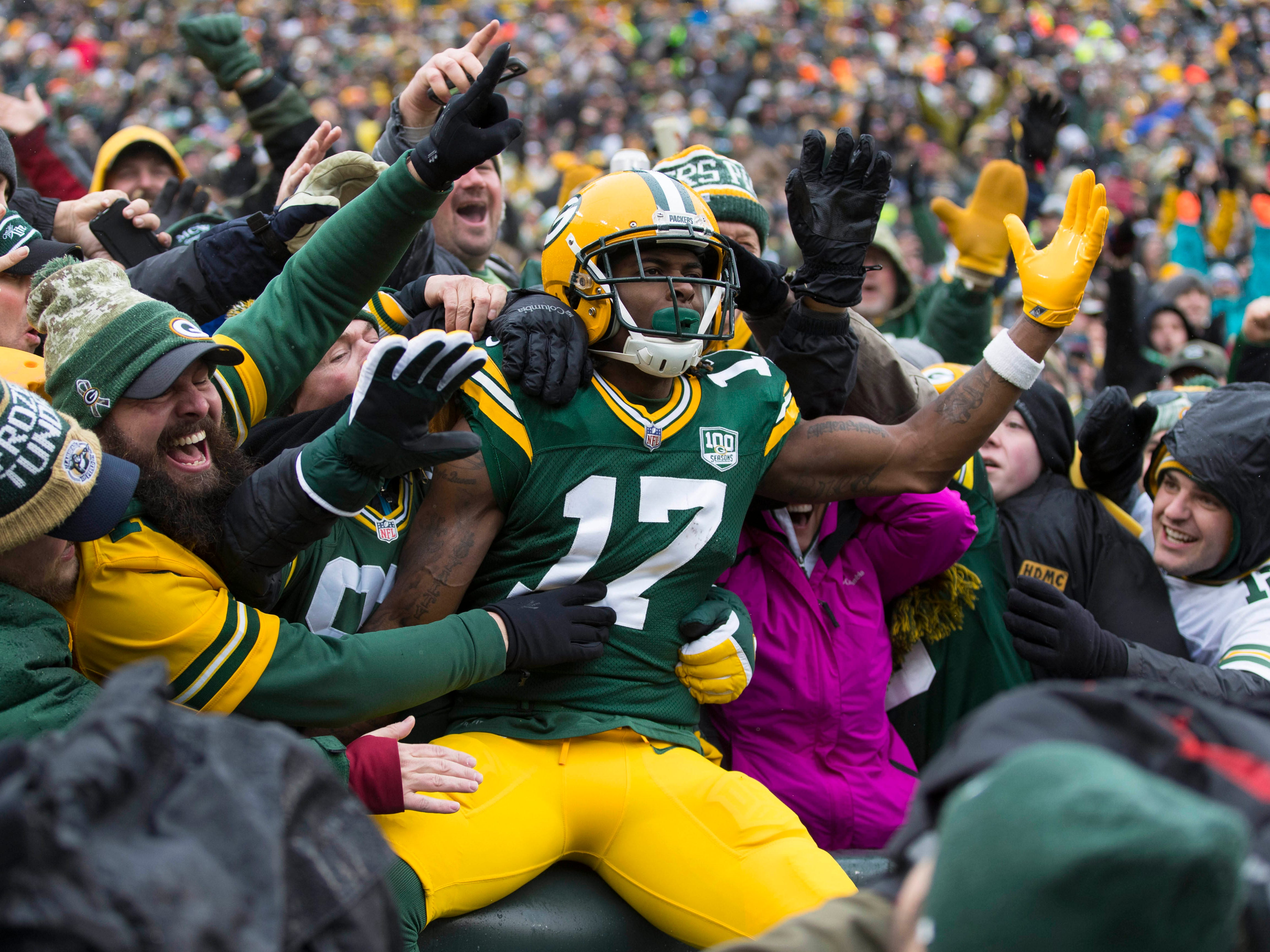 Green Bay Packers wide receiver Davante Adams (17) celebrates after scoring a touchdown during the second quarter against the Arizona Cardinals at Lambeau Field.