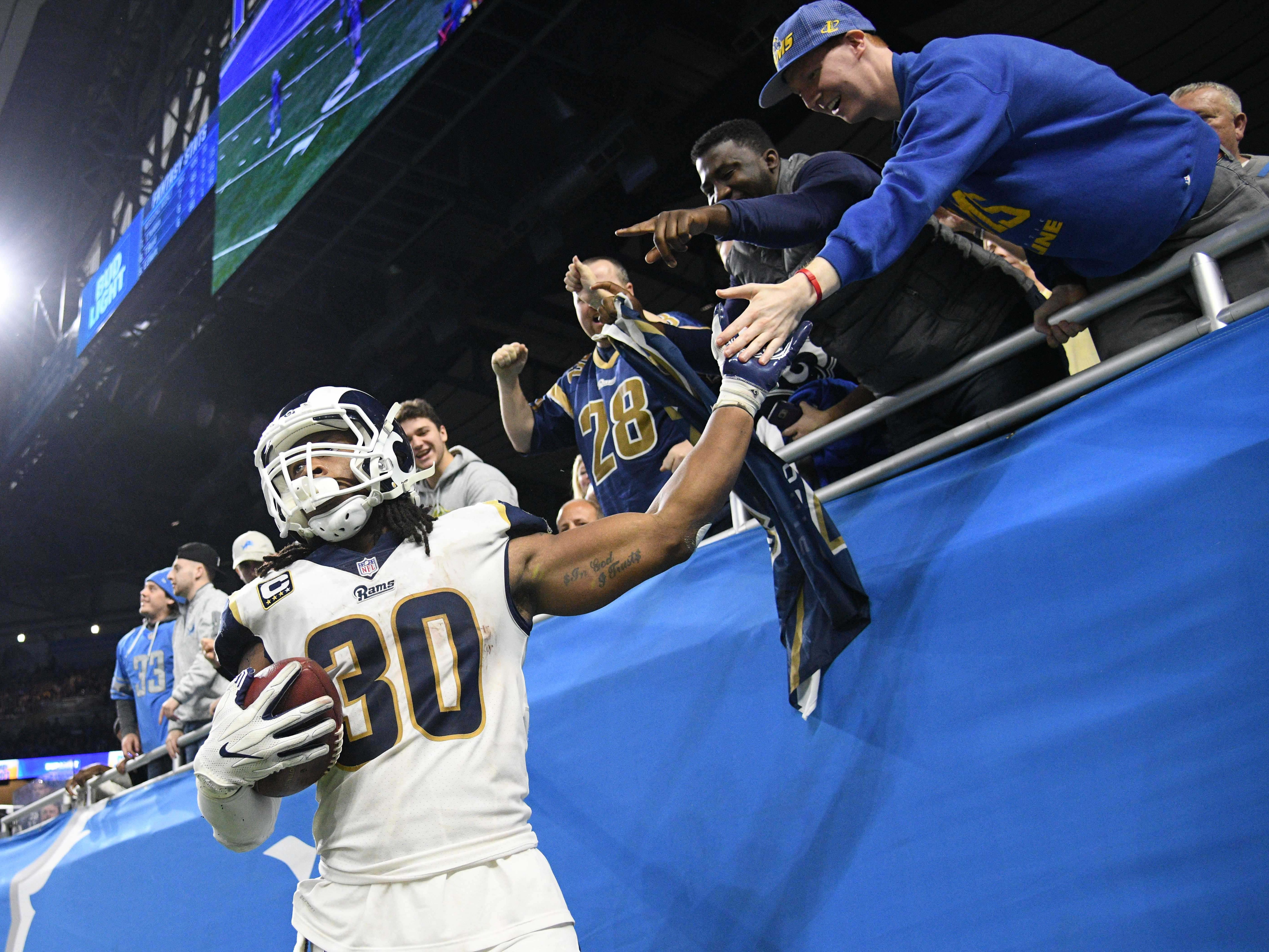 Los Angeles Rams running back Todd Gurley (30) celebrates his touchdown with fans during the second half against the Detroit Lions at Ford Field.