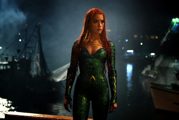 "Amber Heard is ready for action in Mera's warrior ensemble in ""Aquaman."""