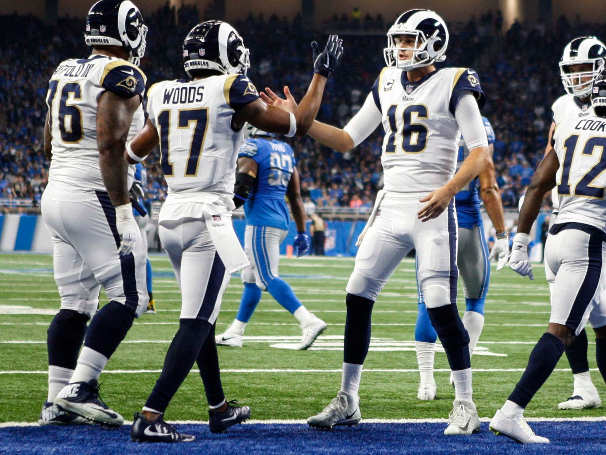 Los Angeles Rams wide receiver Robert Woods (17) and quarterback Jared Goff (16) celebrate after hooking up for a touchdown during the second quarter against the Detroit Lions at Ford Field.
