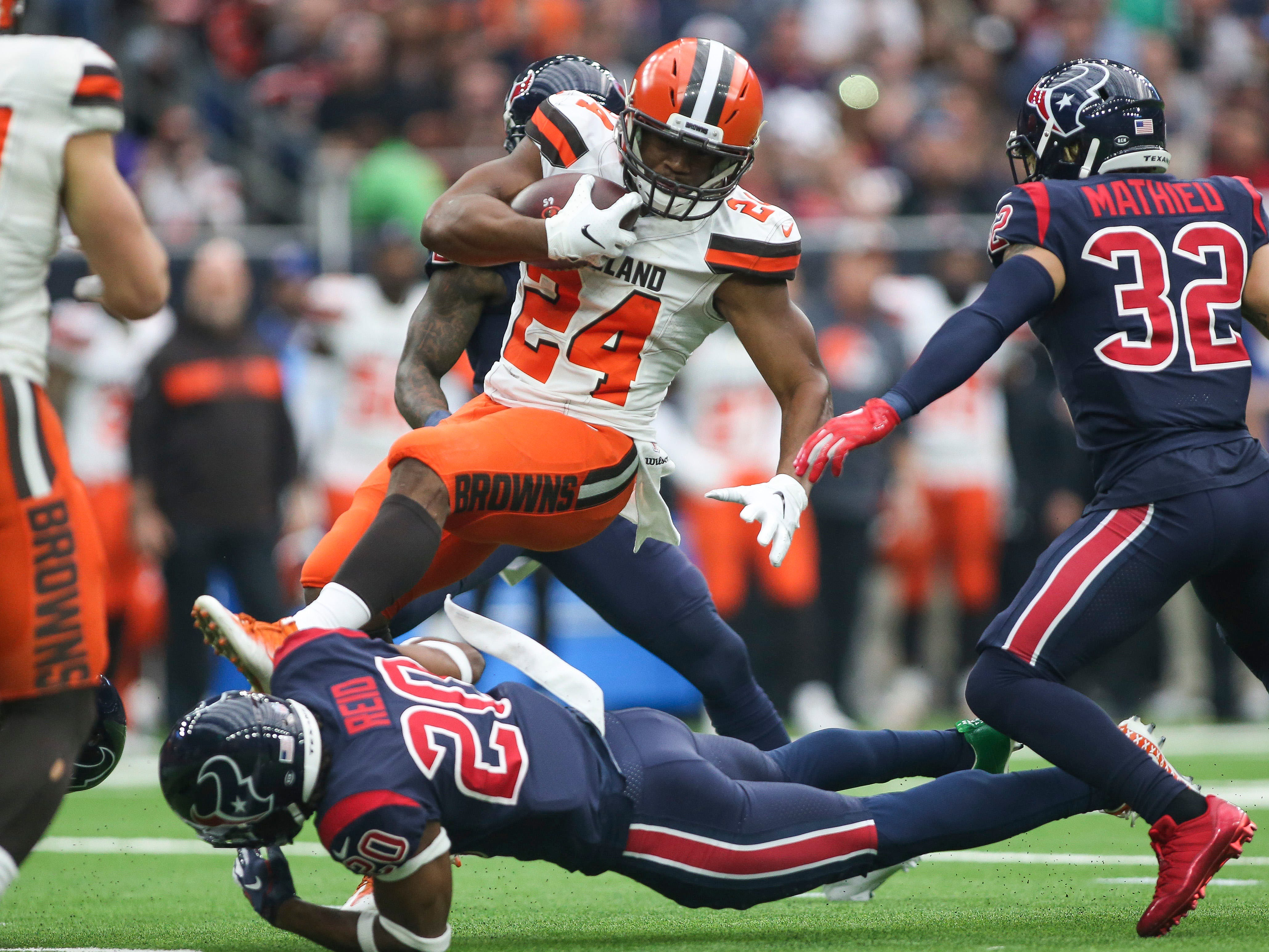 Cleveland Browns running back Nick Chubb (24) runs with the ball as Houston Texans strong safety Justin Reid (20) attempts to make a tackle during the first quarter at NRG Stadium.
