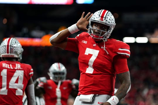 Ohio State Buckeyes quarterback Dwayne Haskins (7) celebrates with teammates after throwing a touchdown pass against the Northwestern Wildcats in the first half of the Big Ten conference championship game at Lucas Oil Stadium.