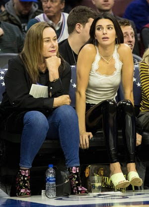 Kendall Jenner sits with Philadelphia 76ers guard Ben Simmons' mother Julie Simmons (L) during the fourth quarter of a game against the Washington Wizards at Wells Fargo Center.