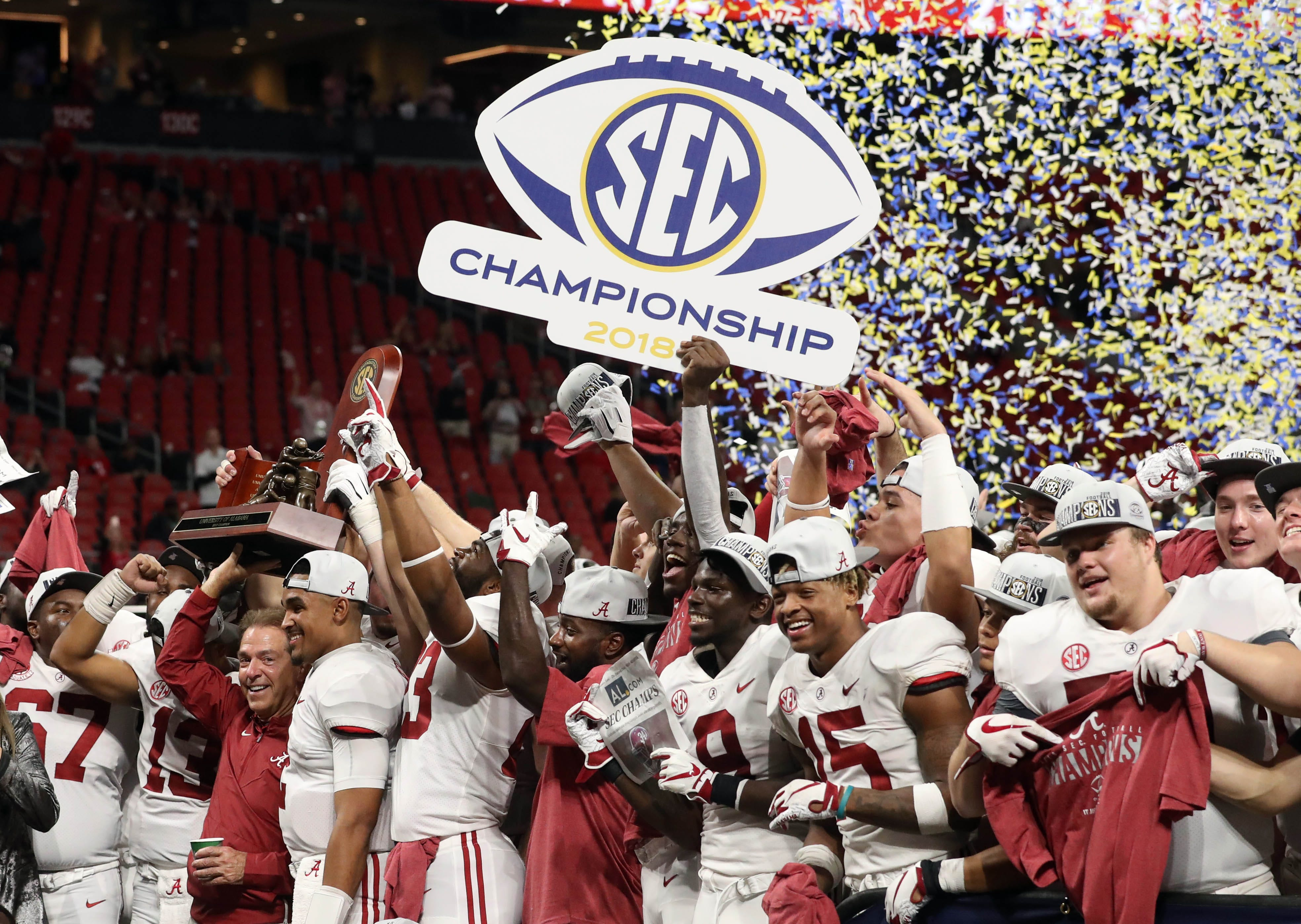 Alabama players celebrate after defeating Georgia in the 2018 SEC championship game.